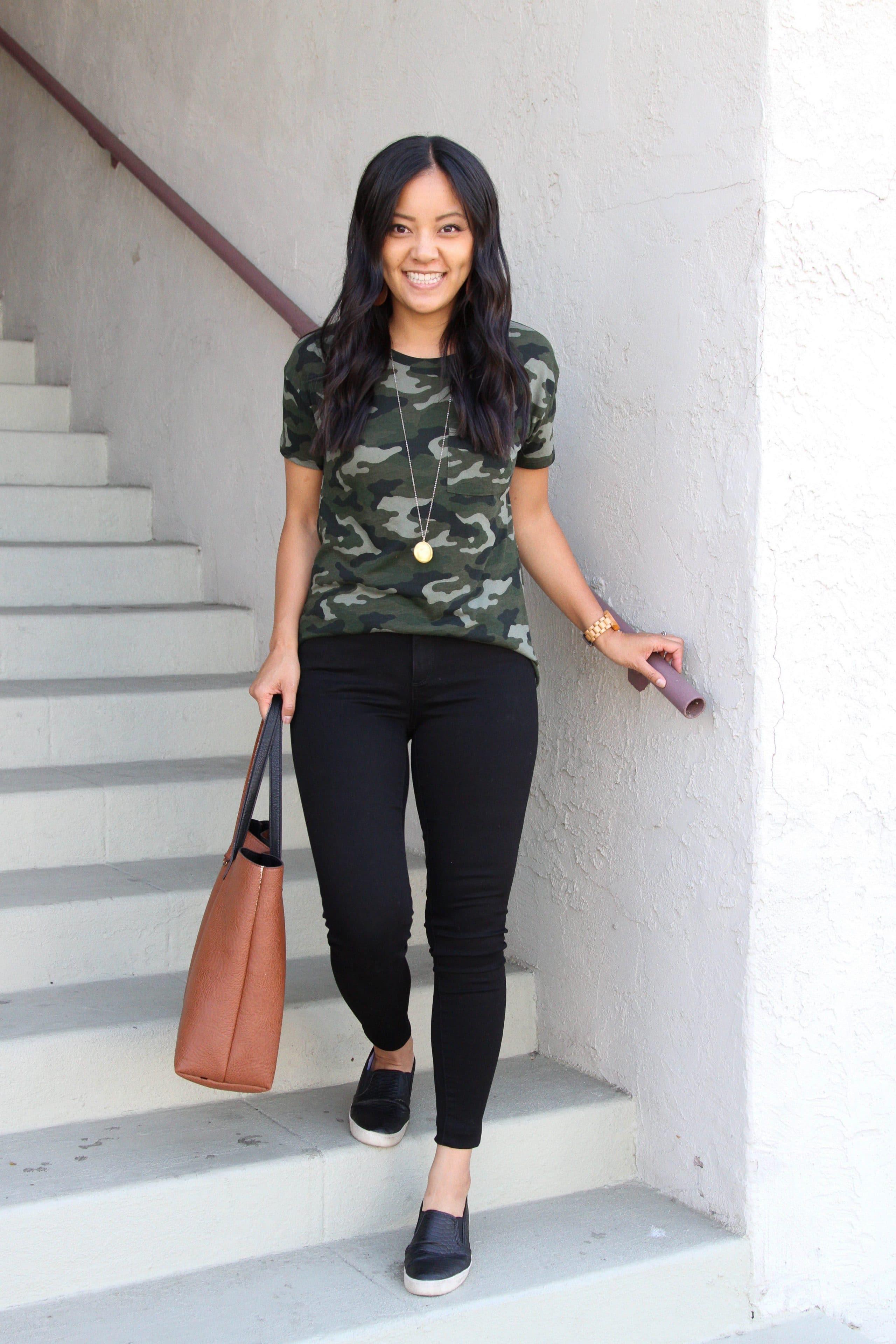 green camo shirt + black skinny pants + black slip on shoes + cognac tote