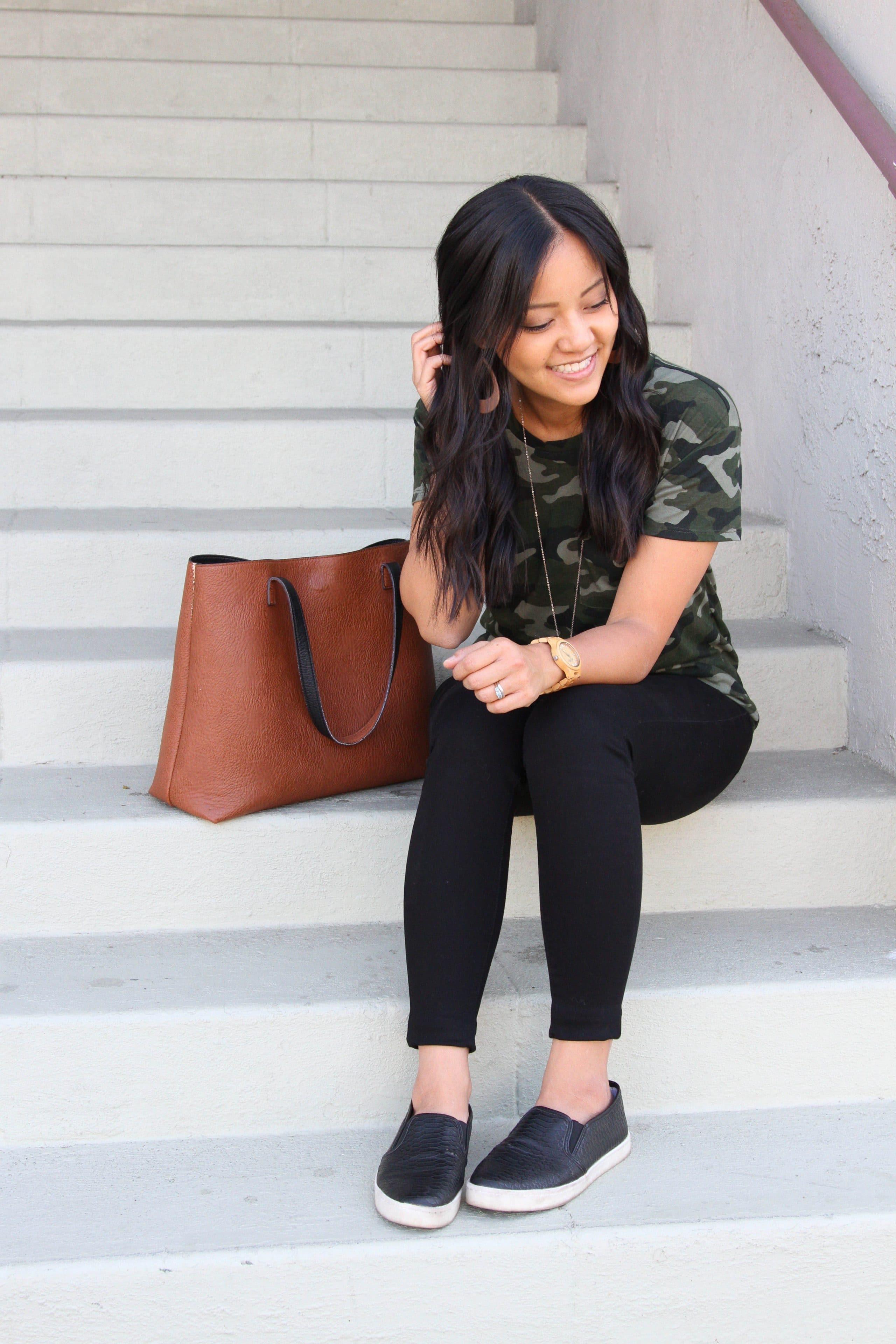 black slip on shoes + green camo shirt + black skinny pants + cognac tote