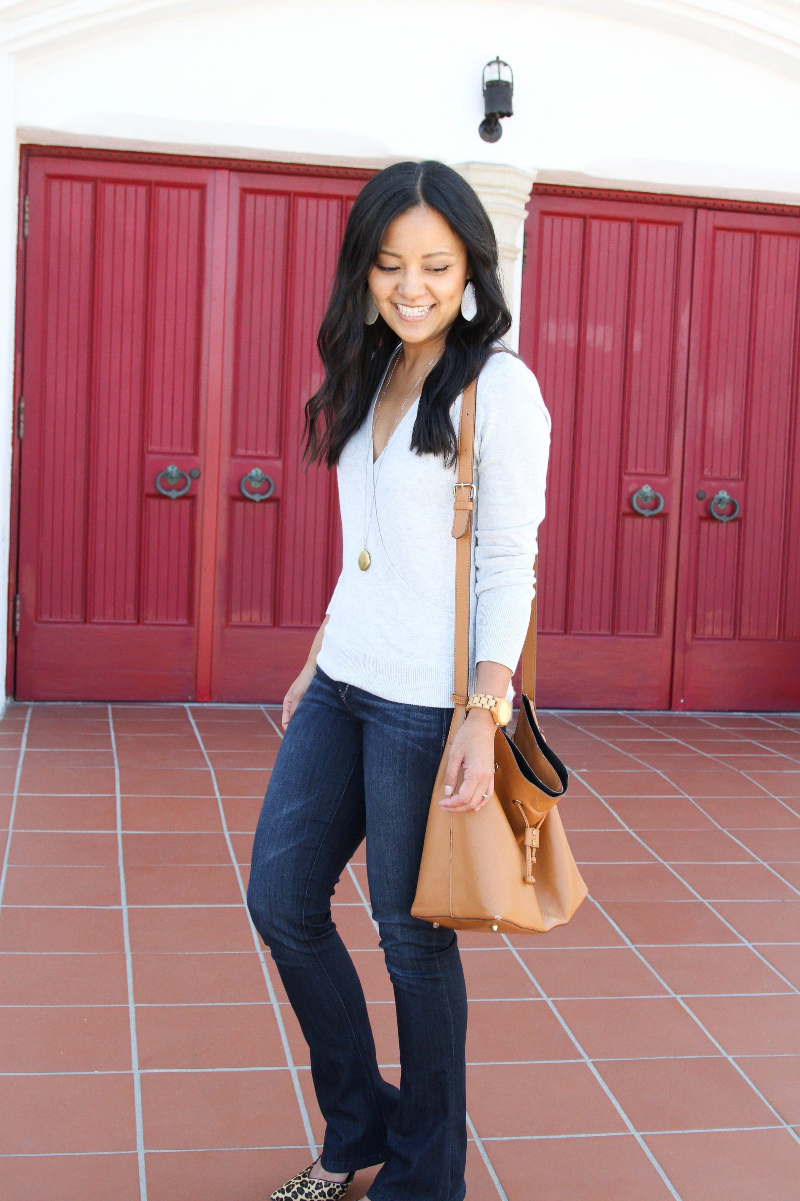 grey sweater + bootcut jeans + leopard print heels + long pendant necklace + tote