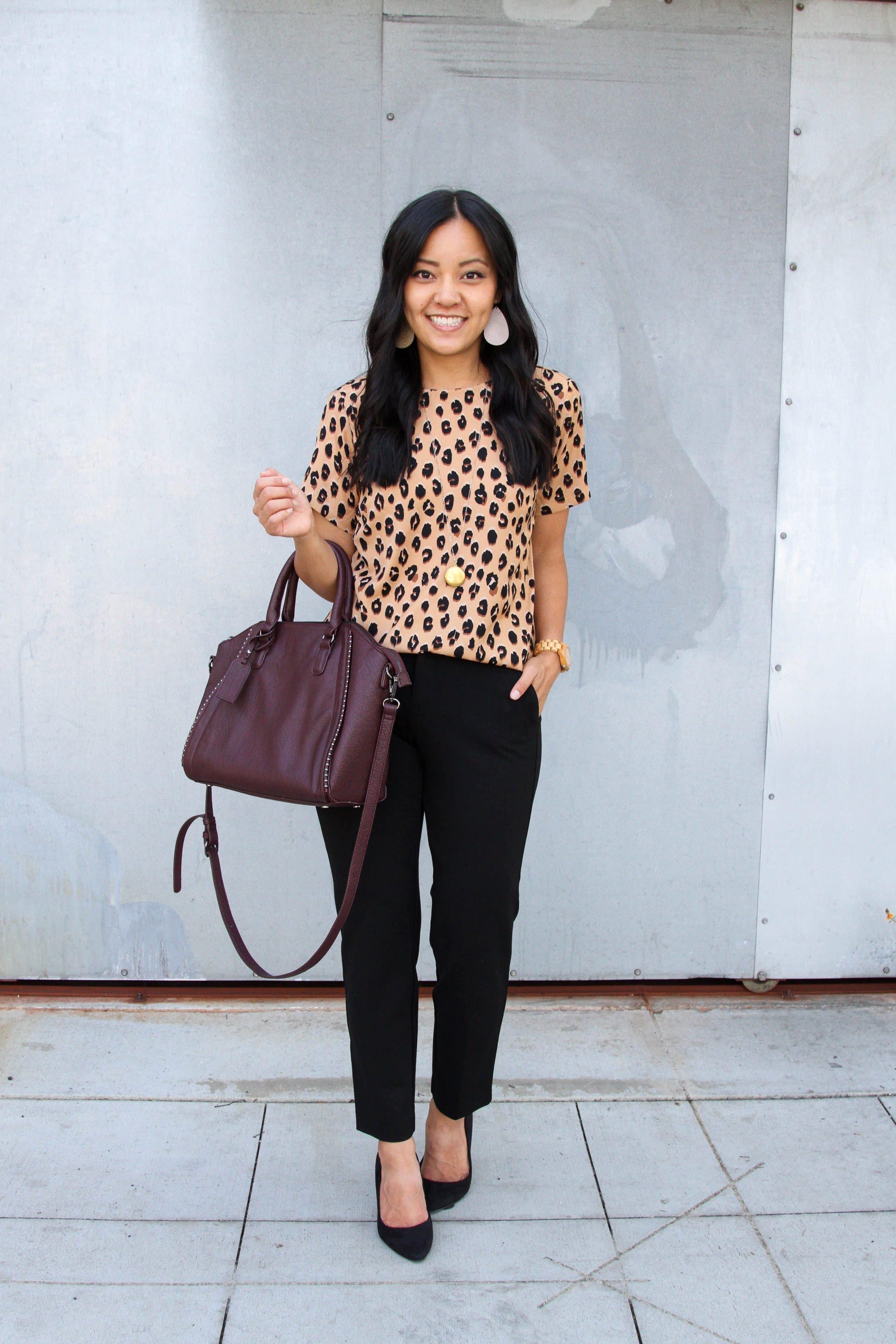 business casual + leopard print top + black pants + black heels + maroon tote