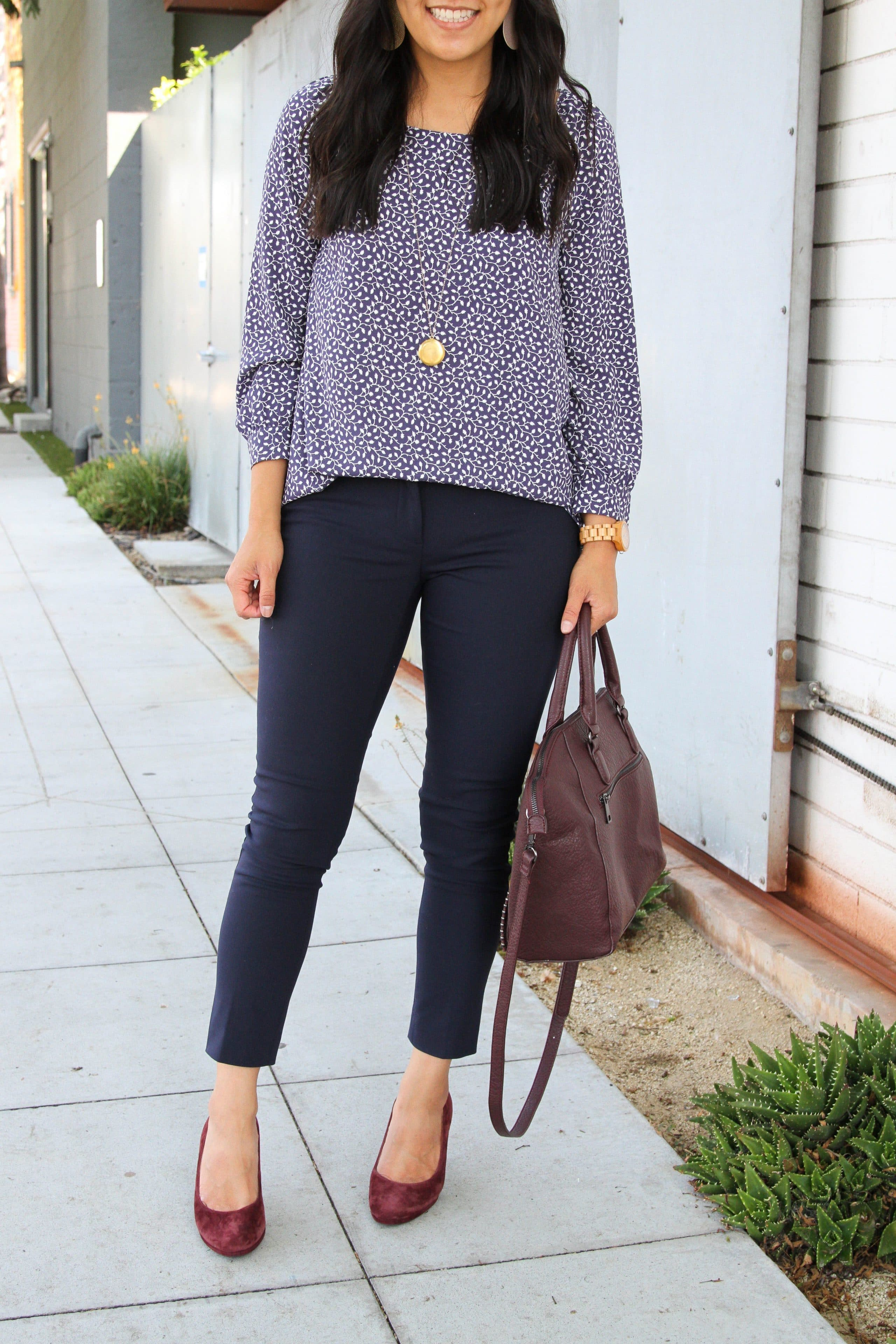 navy pants + business casual + navy and white floral top + maroon pumps + maroon purse