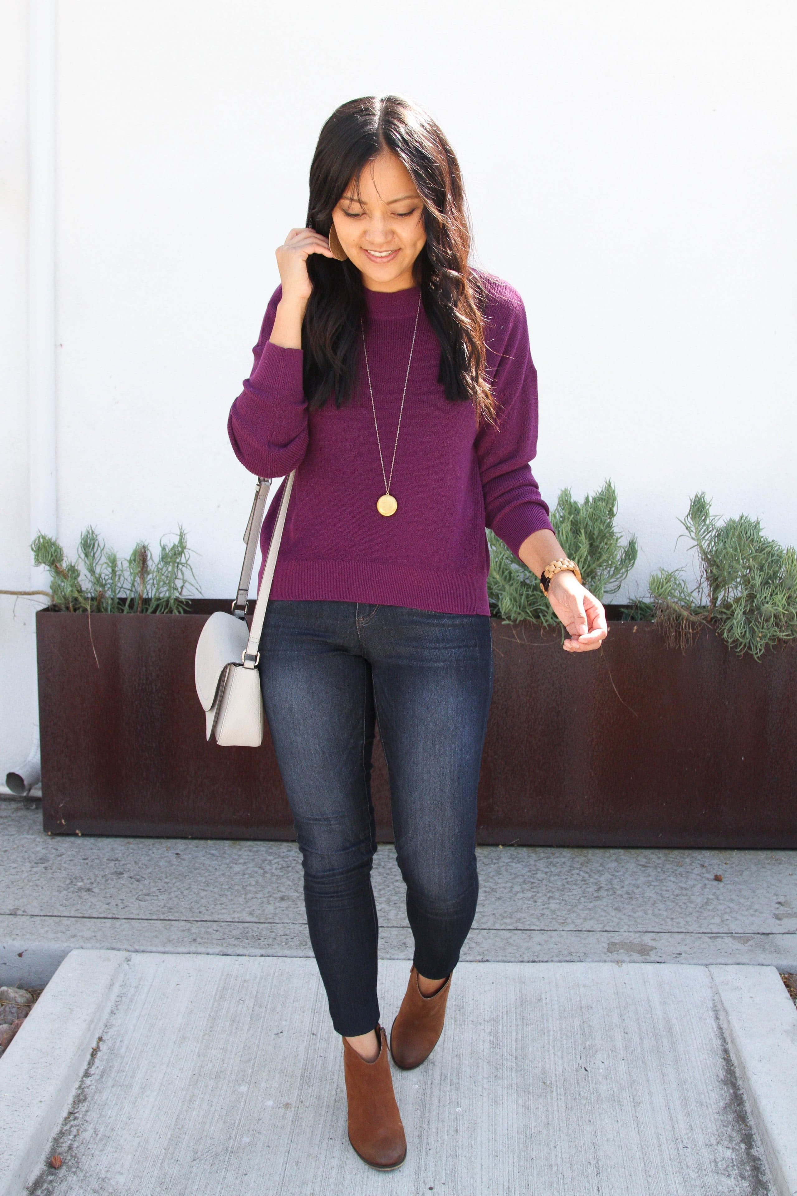 maroon sweater + skinny jeans + brown booties + grey purse + long pendant necklace
