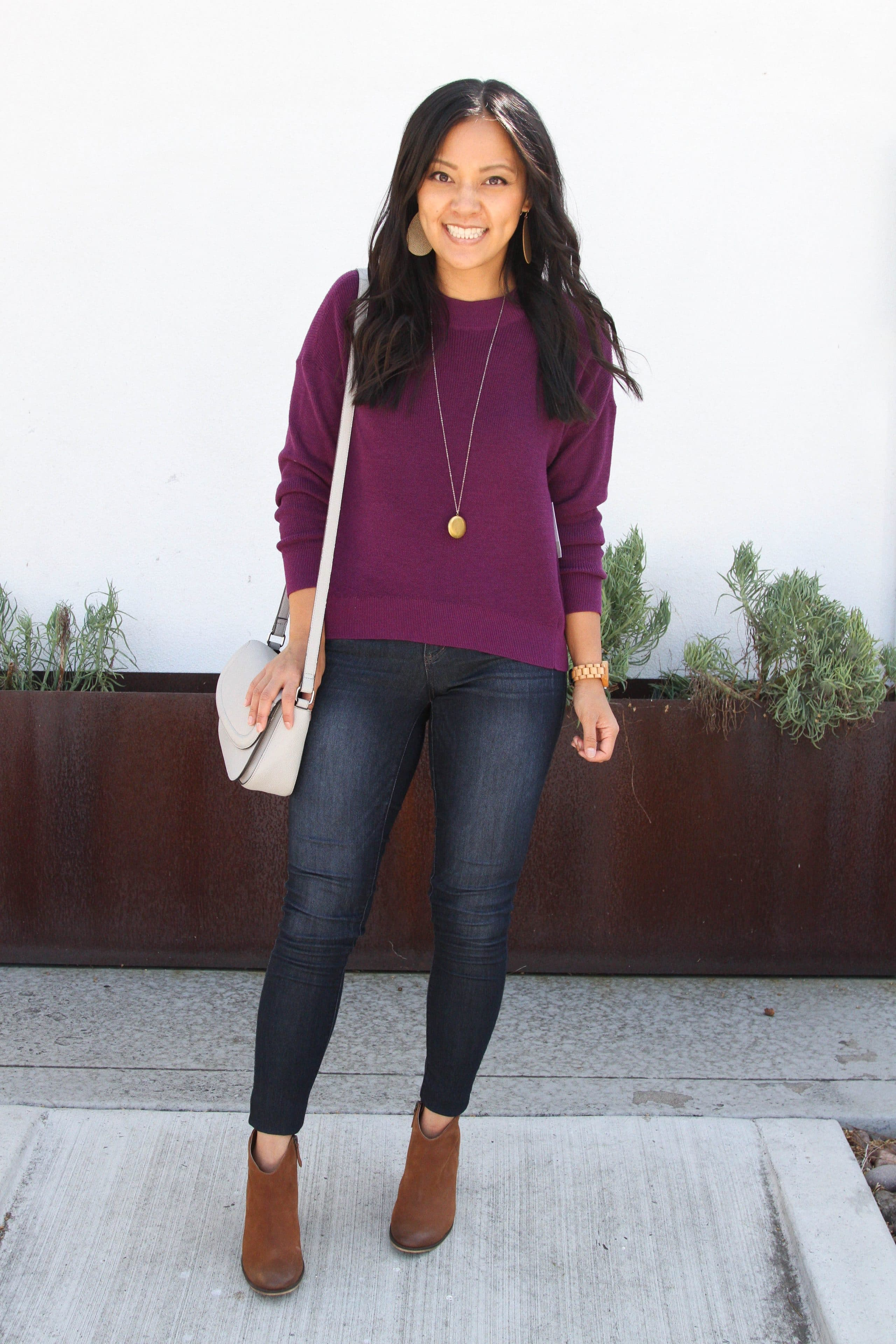 skinny jeans + maroon sweater + brown booties + grey purse + long pendant necklace