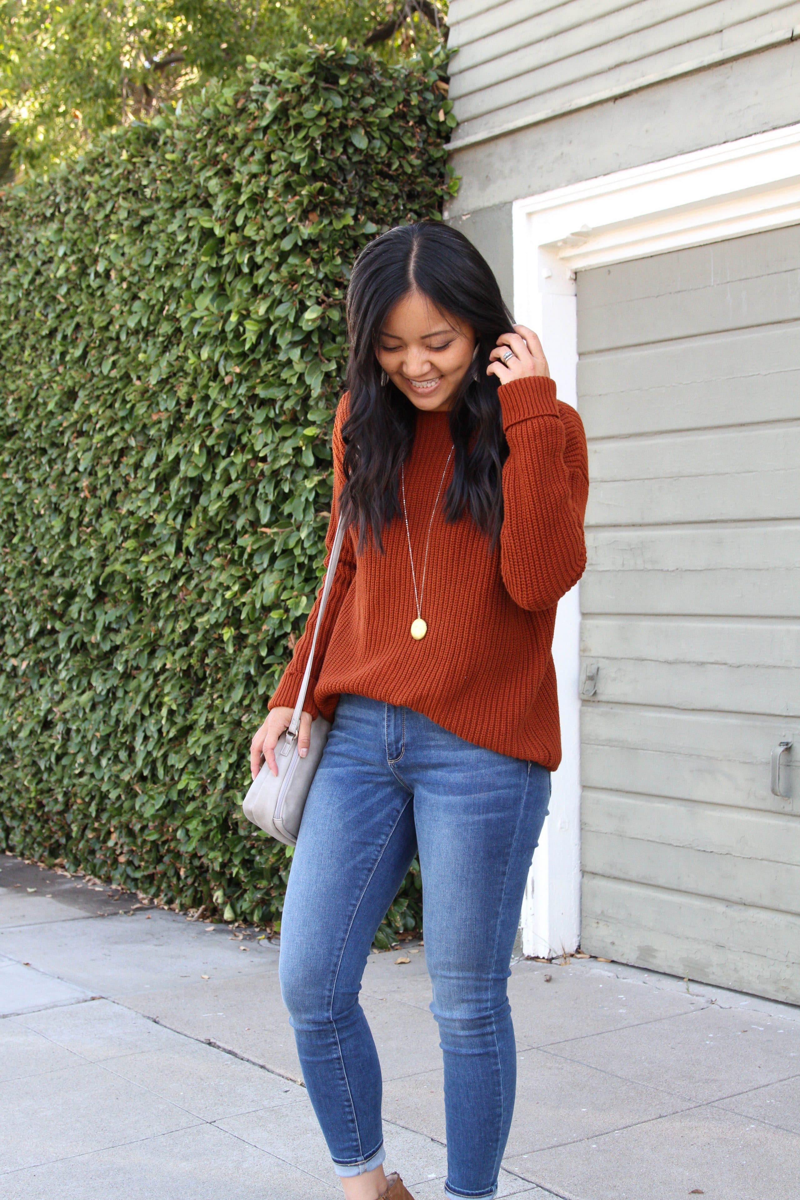 skinny jeans + rust orange sweater + taupe booties + grey purse