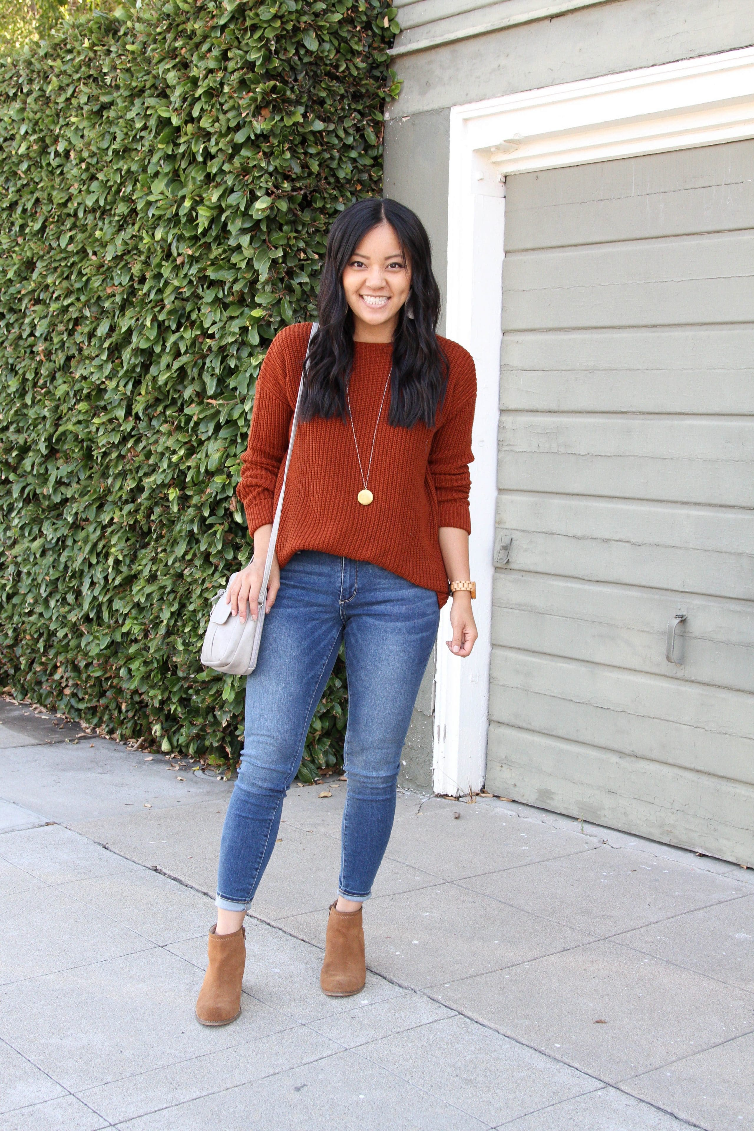 rust orange sweater + taupe booties + skinny jeans + grey purse