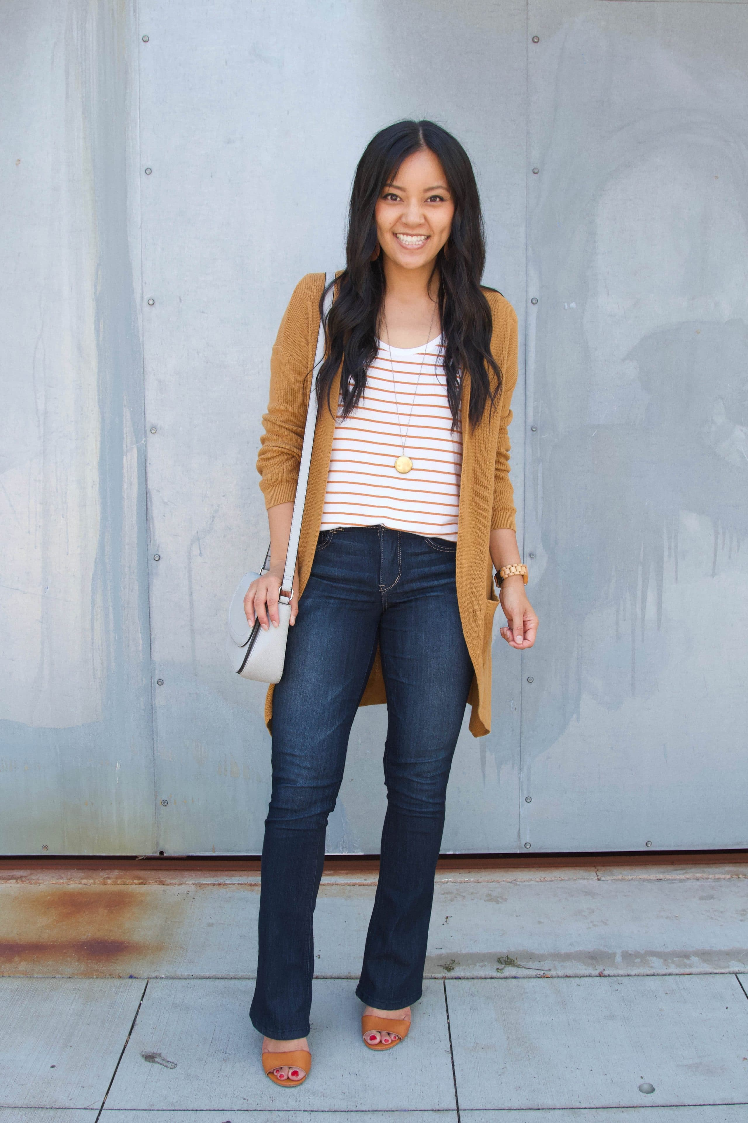 striped tee + orange cardigan + bootcut jeans + wedges