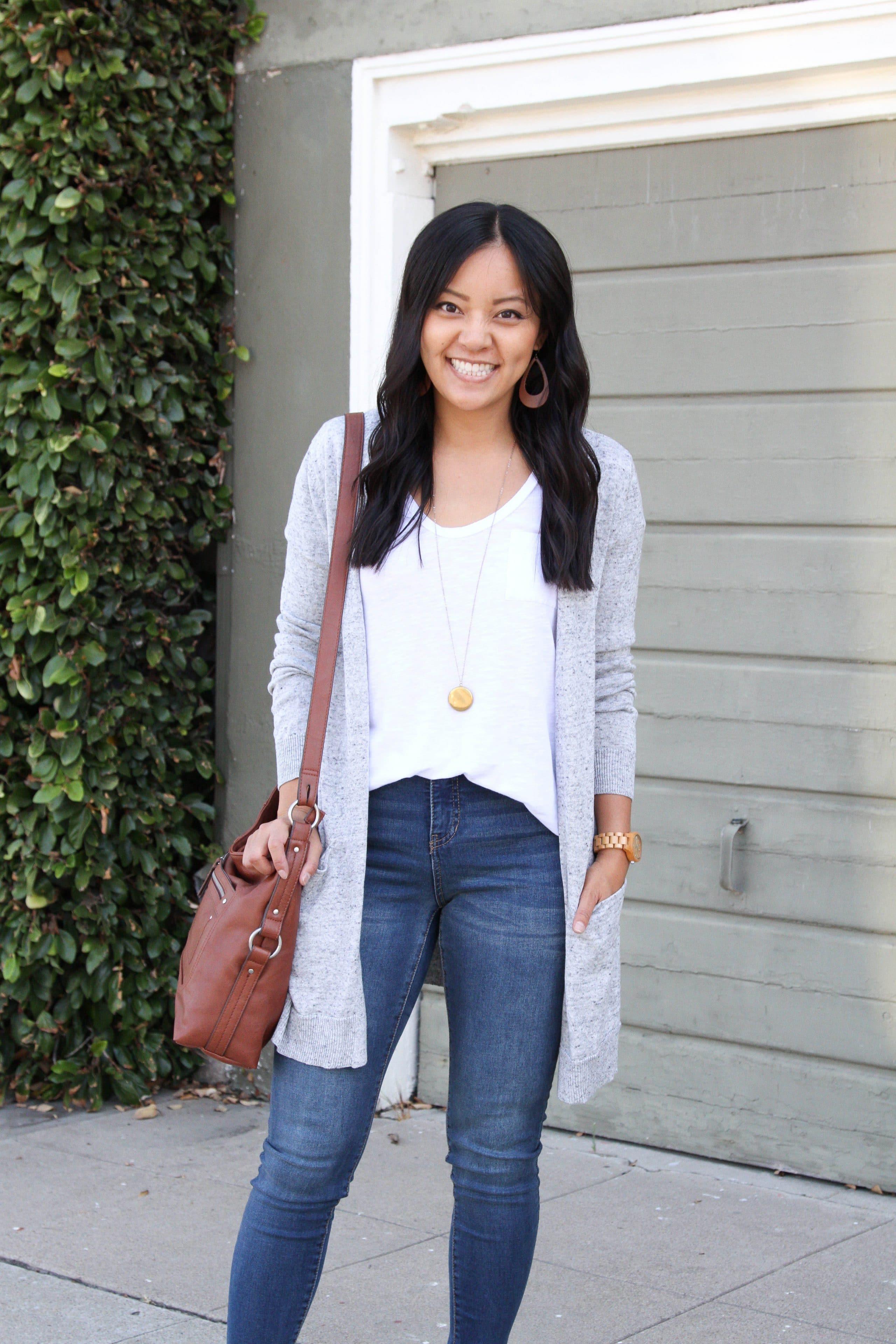 white tee + skinny jeans + grey sweater + tan slip on sneakers + cognac purse