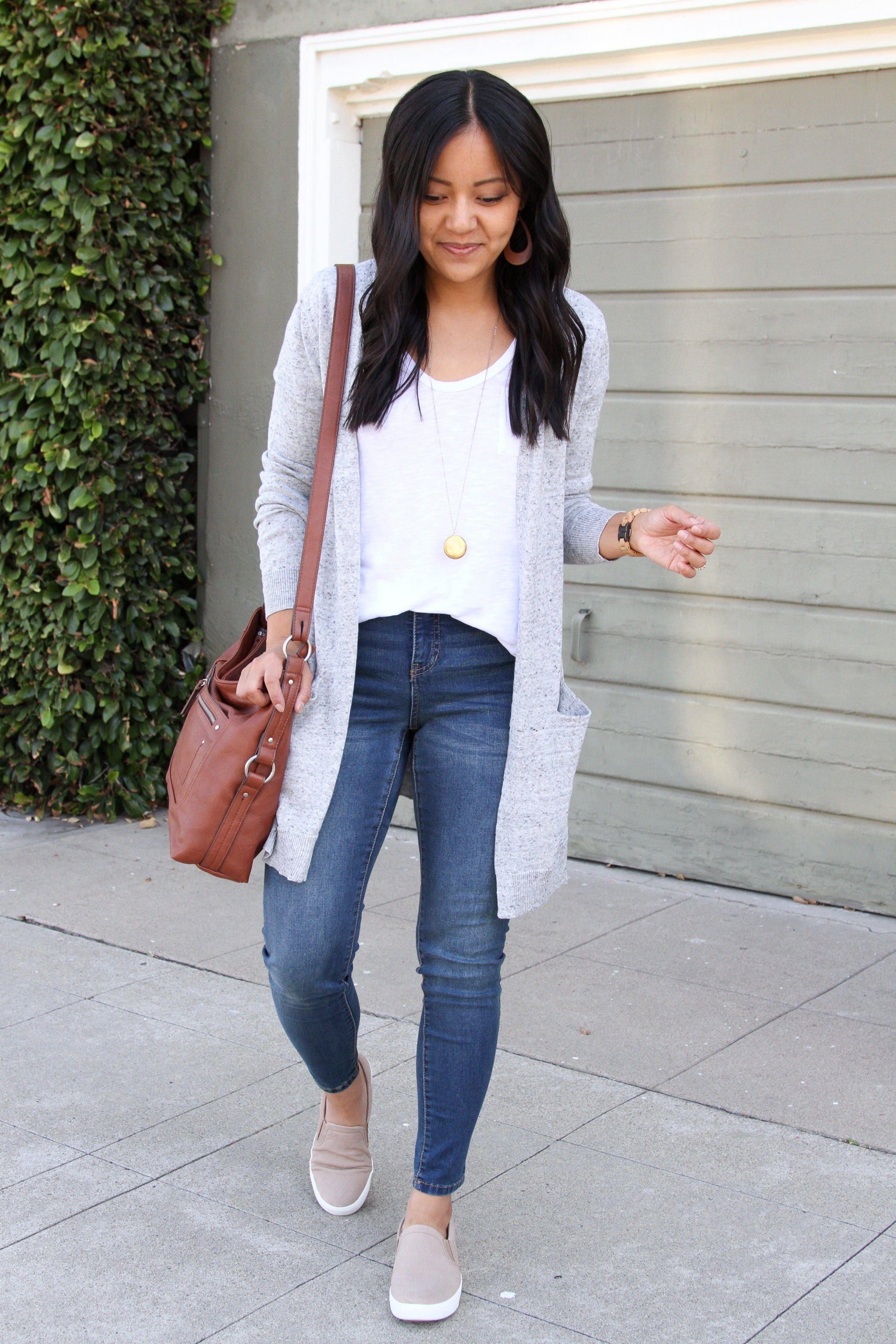 skinny jeans + white tee + grey sweater + tan slip on sneakers + cognac purse