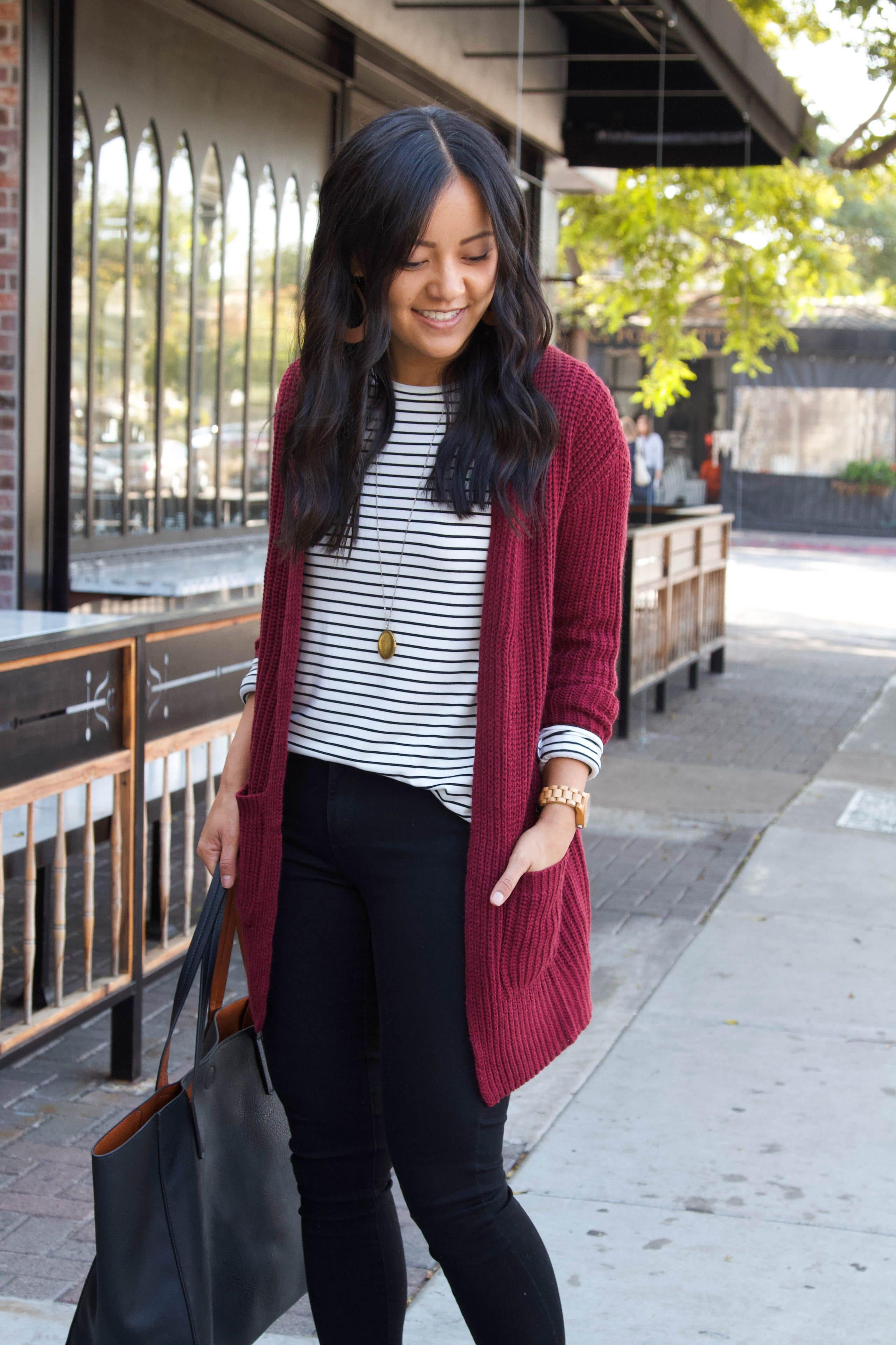 maroon cardigan + black and white striped shirt + black skinny pants + taupe booties + black tote + business casual outfit