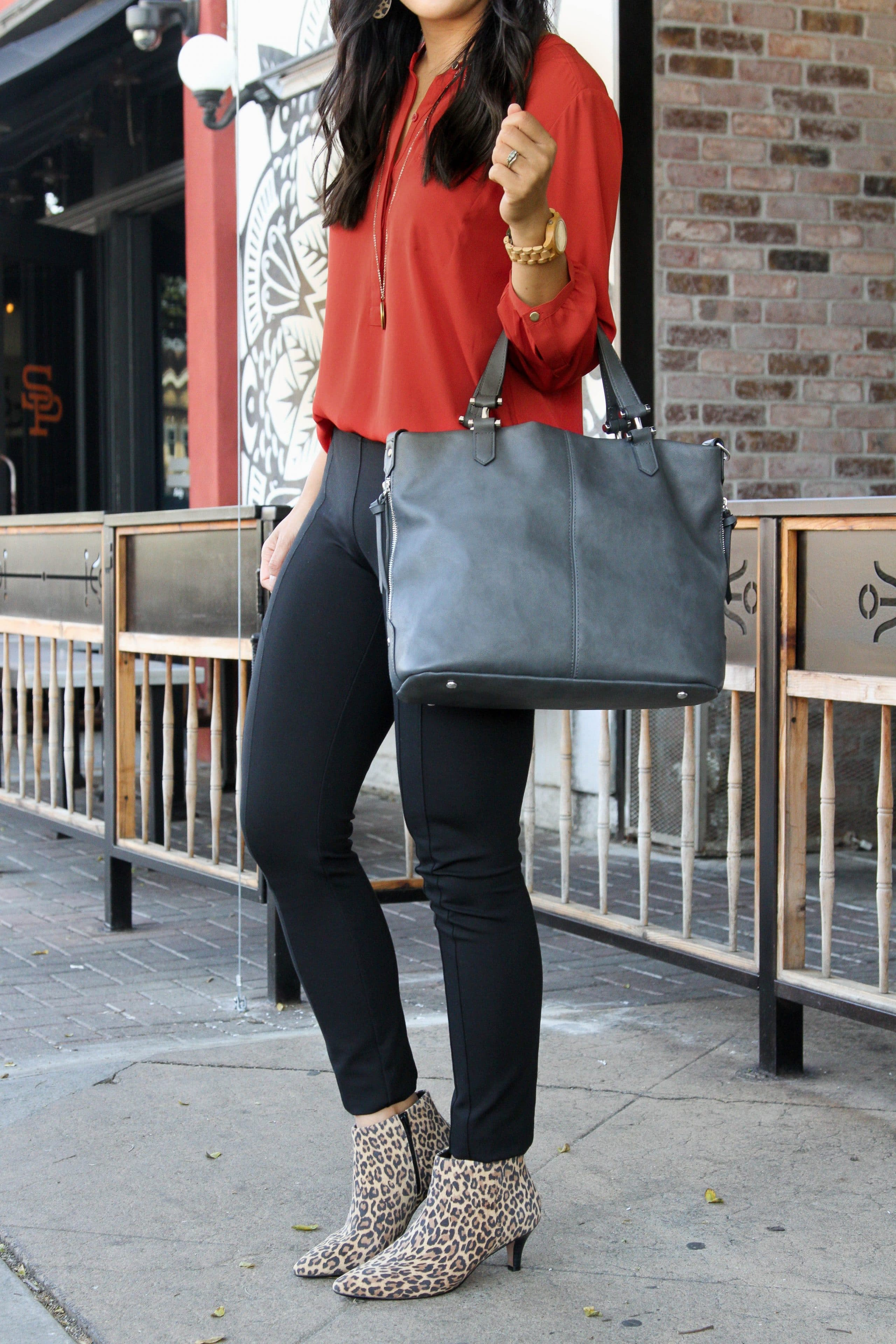 business casual outfit + black skinny pants + burnt orange blouse + leopard print booties + grey purse