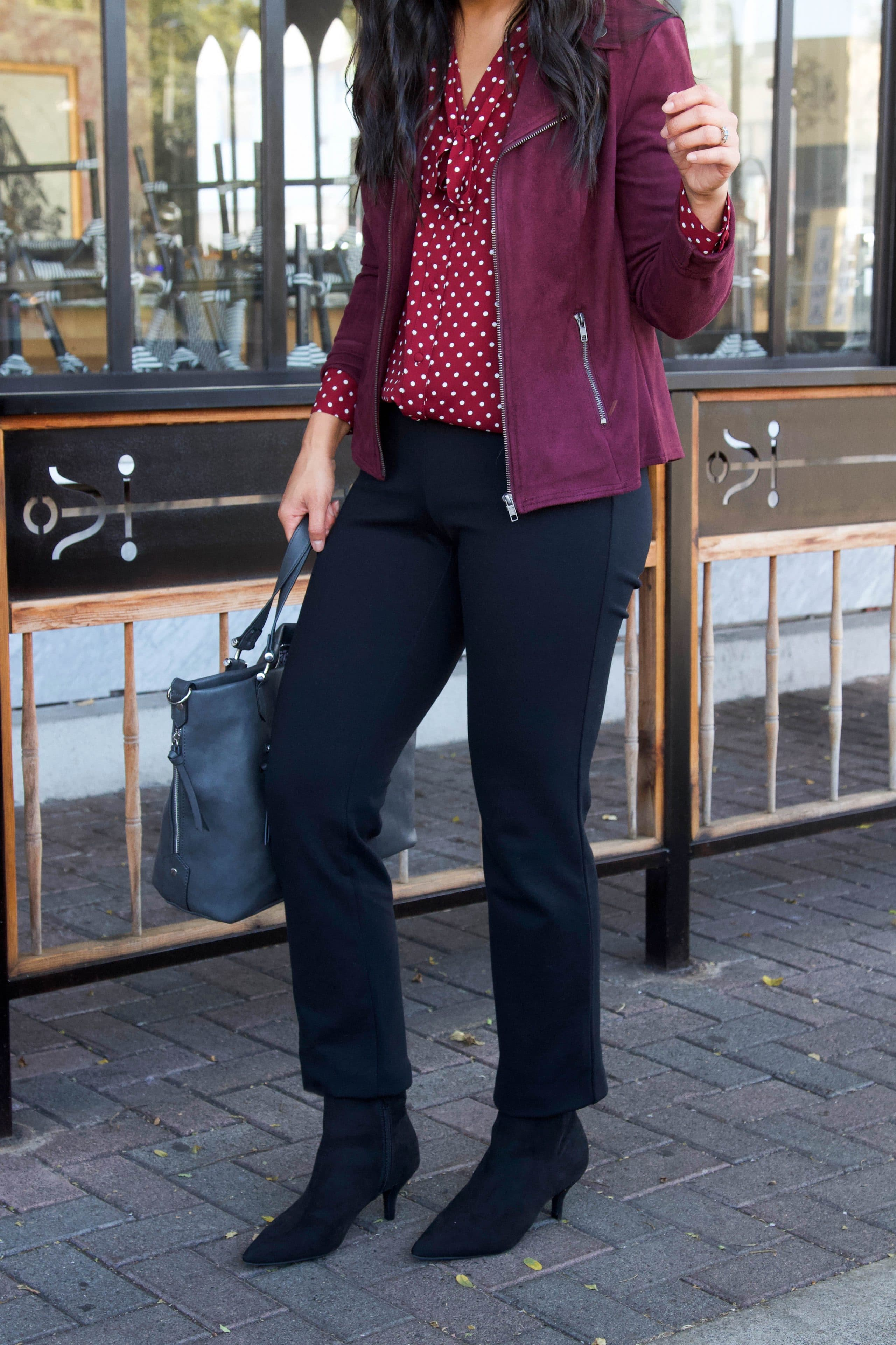 business casual outfit + maroon polka dot top + black straight pants + maroon moto jacket + black booties + grey purse
