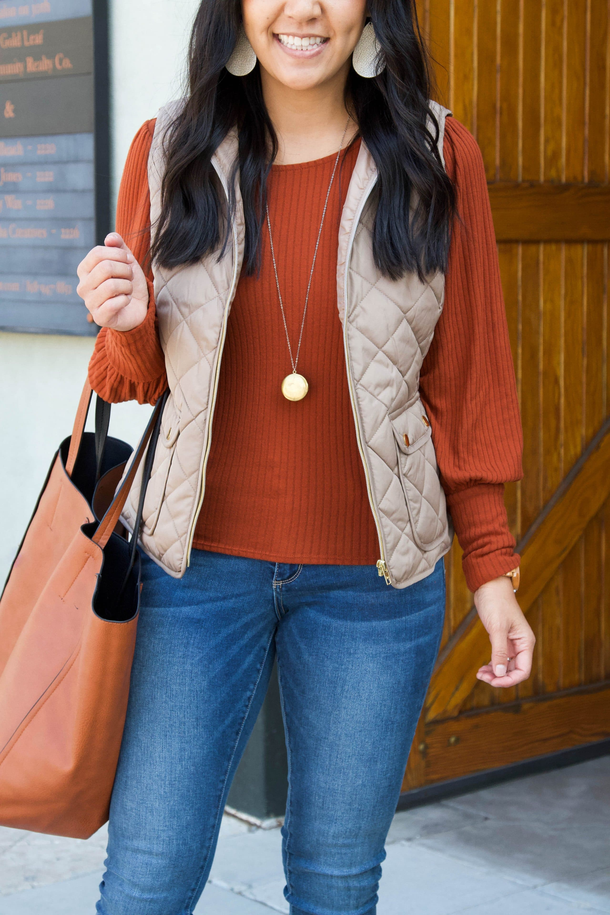 taupe vest, orange sweater, jeans, booties, casual fall outfit