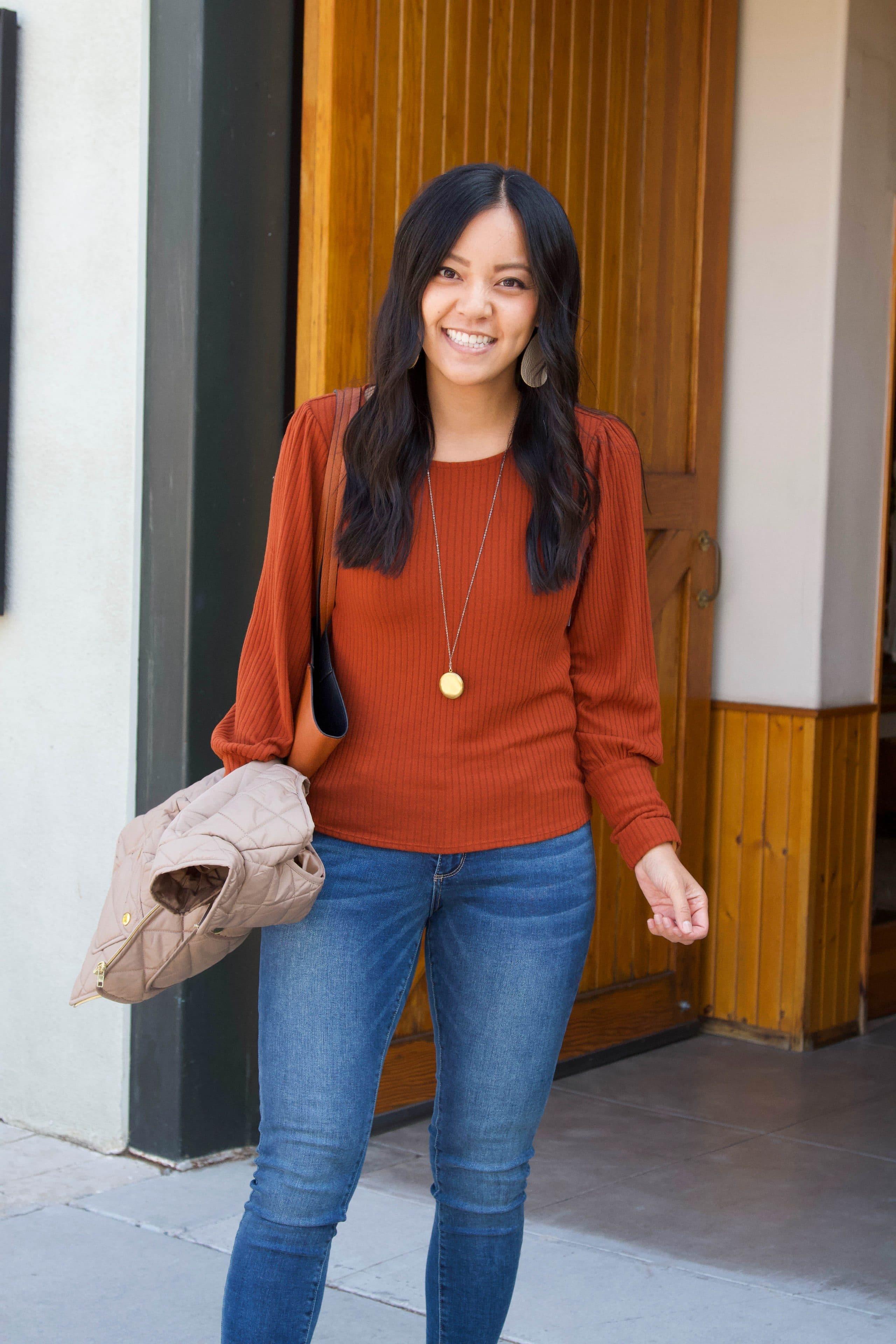 rust orange sweater + skinny jeans+ tan vest + taupe booties + cognac tote
