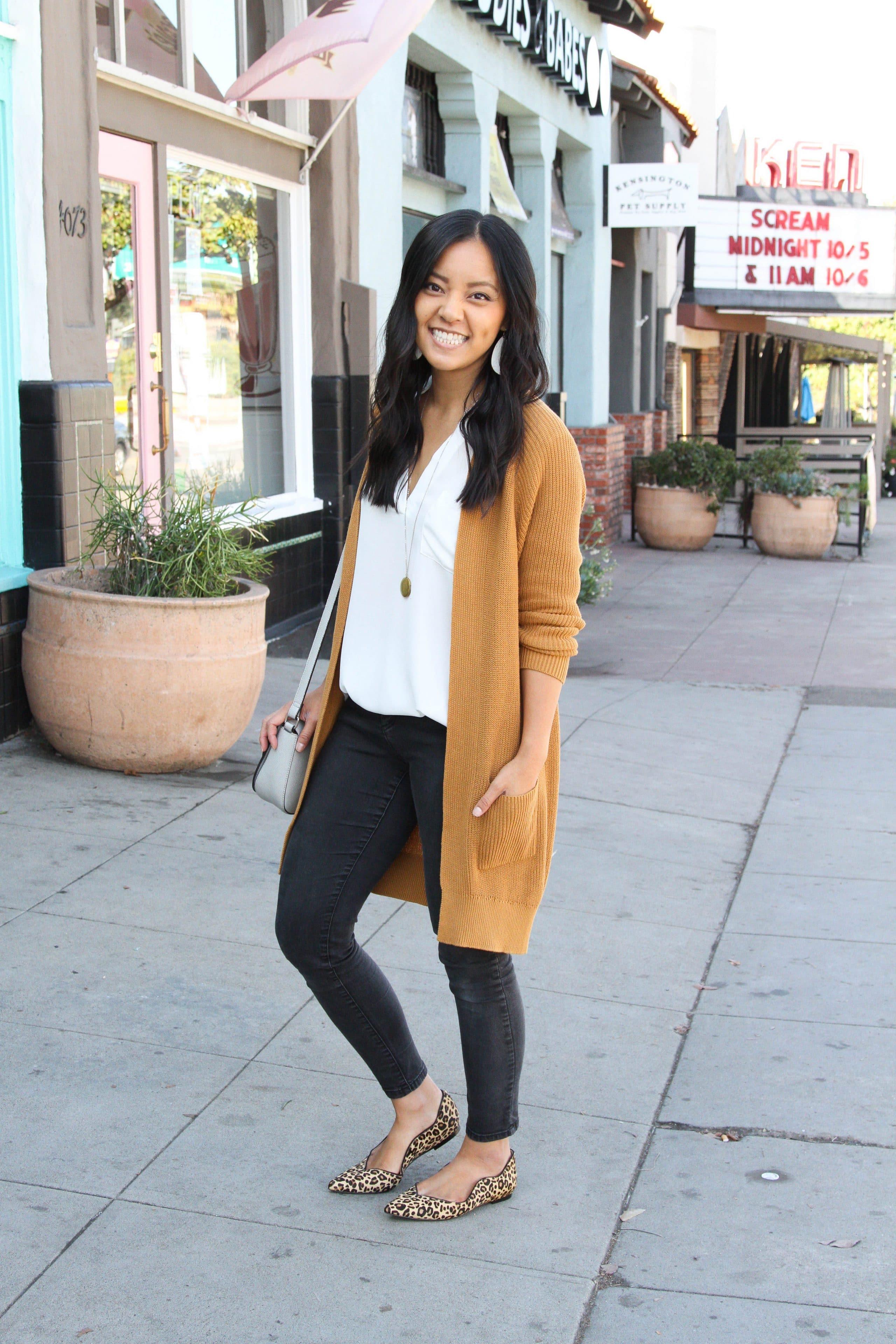 black skinny jeans + white tunic + long cardigan + leopard print flats