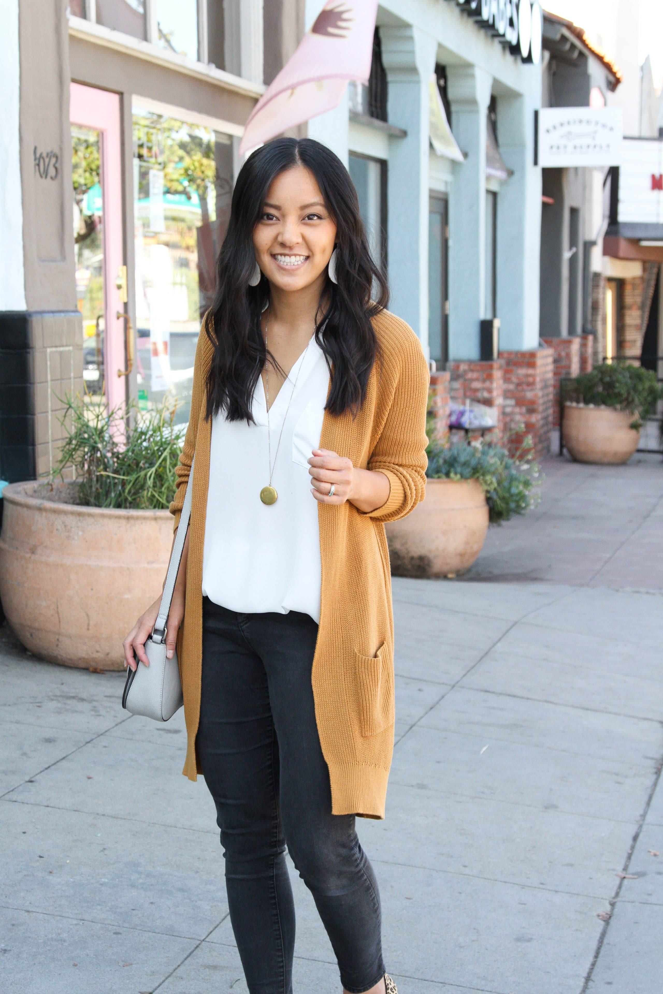 long cardigan + white tunic + black skinny jeans + leopard print flats
