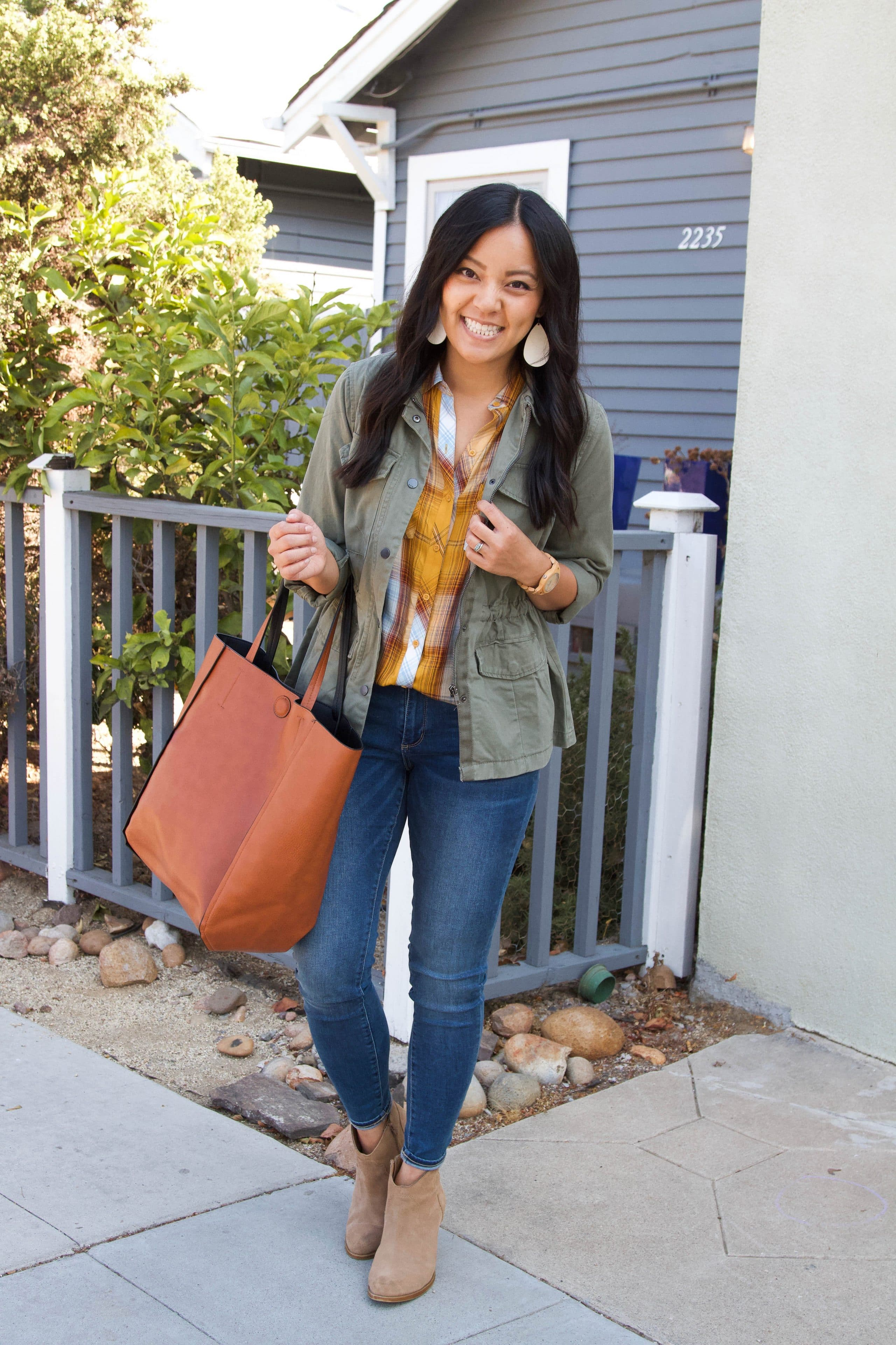 yellow plaid top + olive utility jacket + skinny jeans + taupe booties + cognac tote
