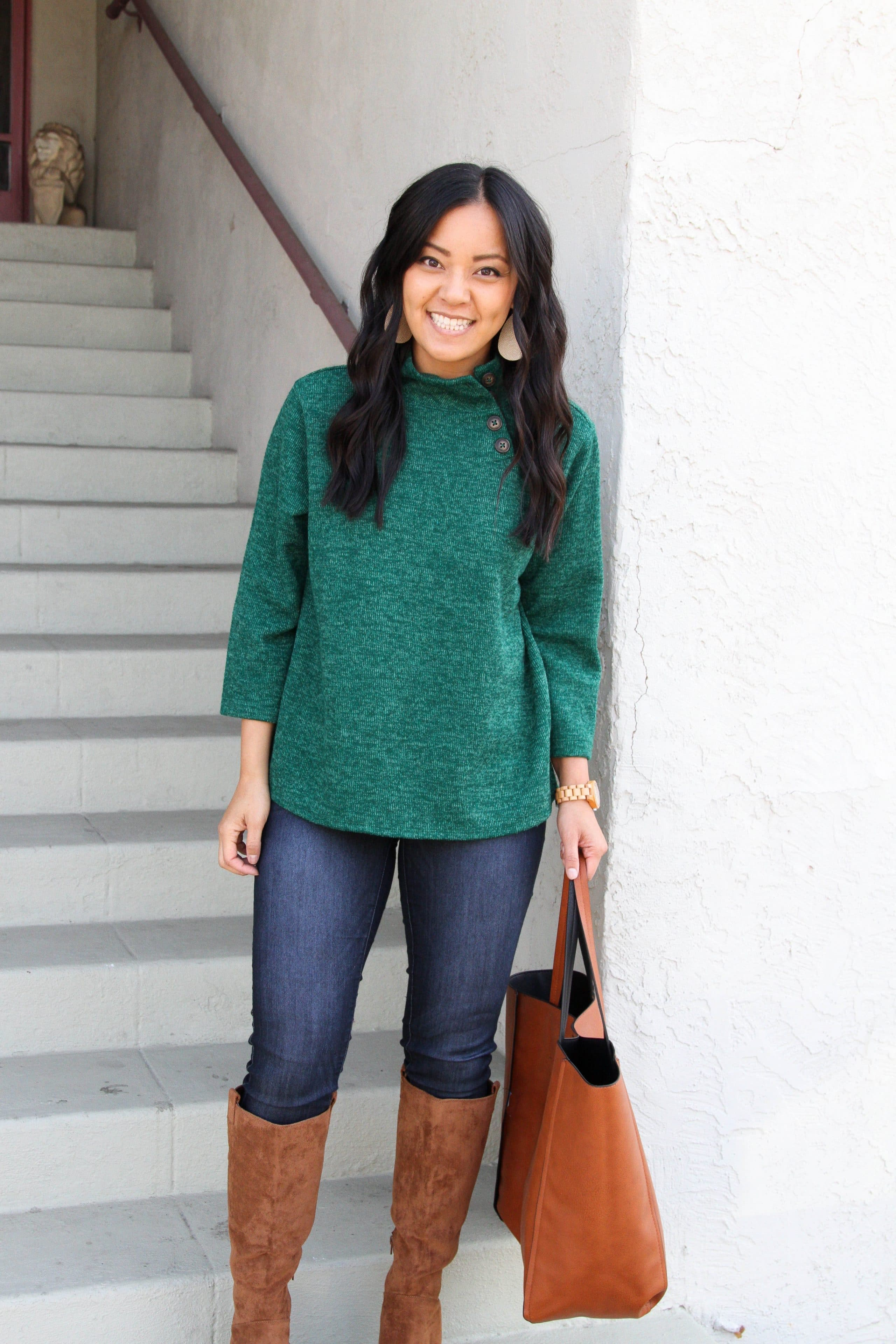 skinny jeans + green sweater + suede boots + cognac tote
