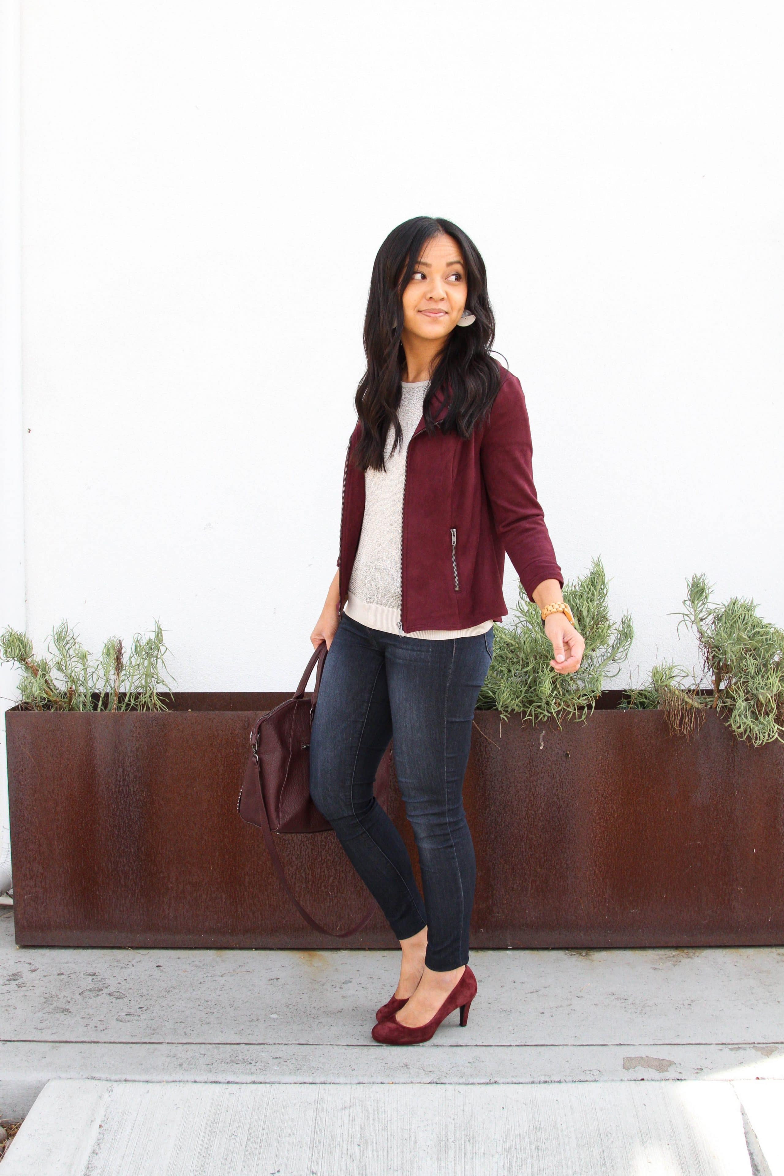skinny jeans + cream sequin top + maroon moto jacket + maroon heels + maroon bag