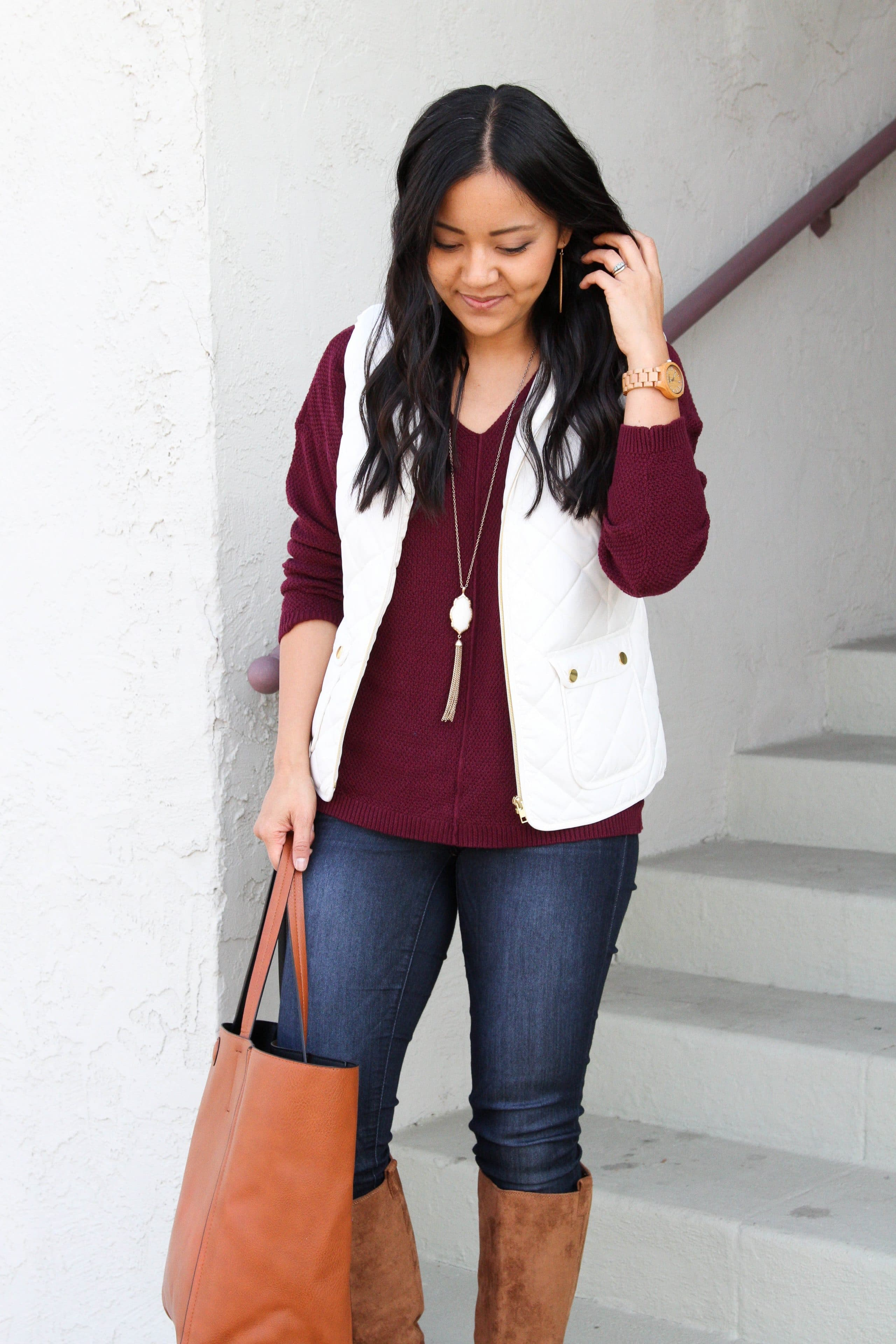maroon sweater + white vest + skinny jeans + suede boots + cognac tote