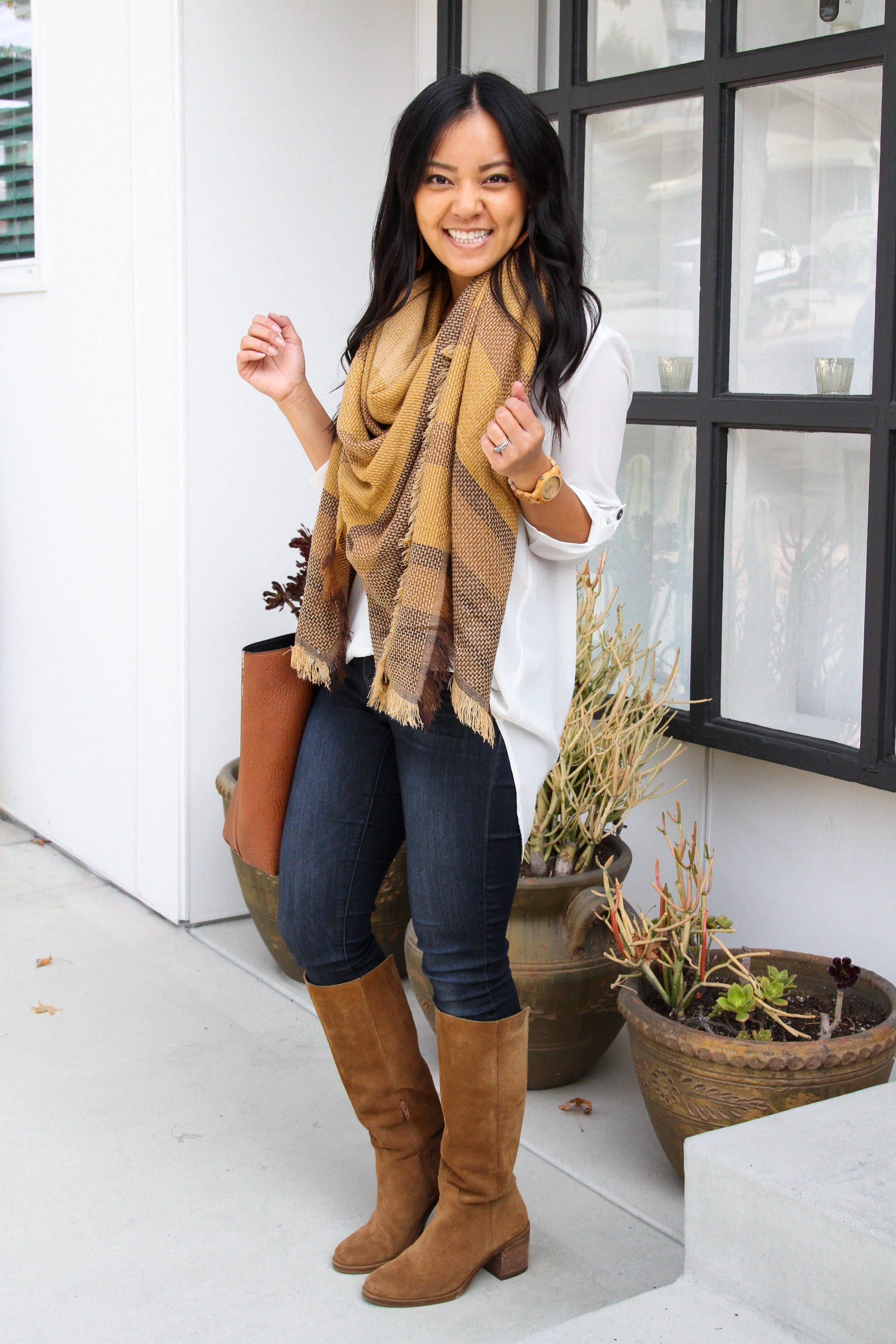 skinny jeans + white tunic + yellow blanket scarf + suede boots + cognac bag