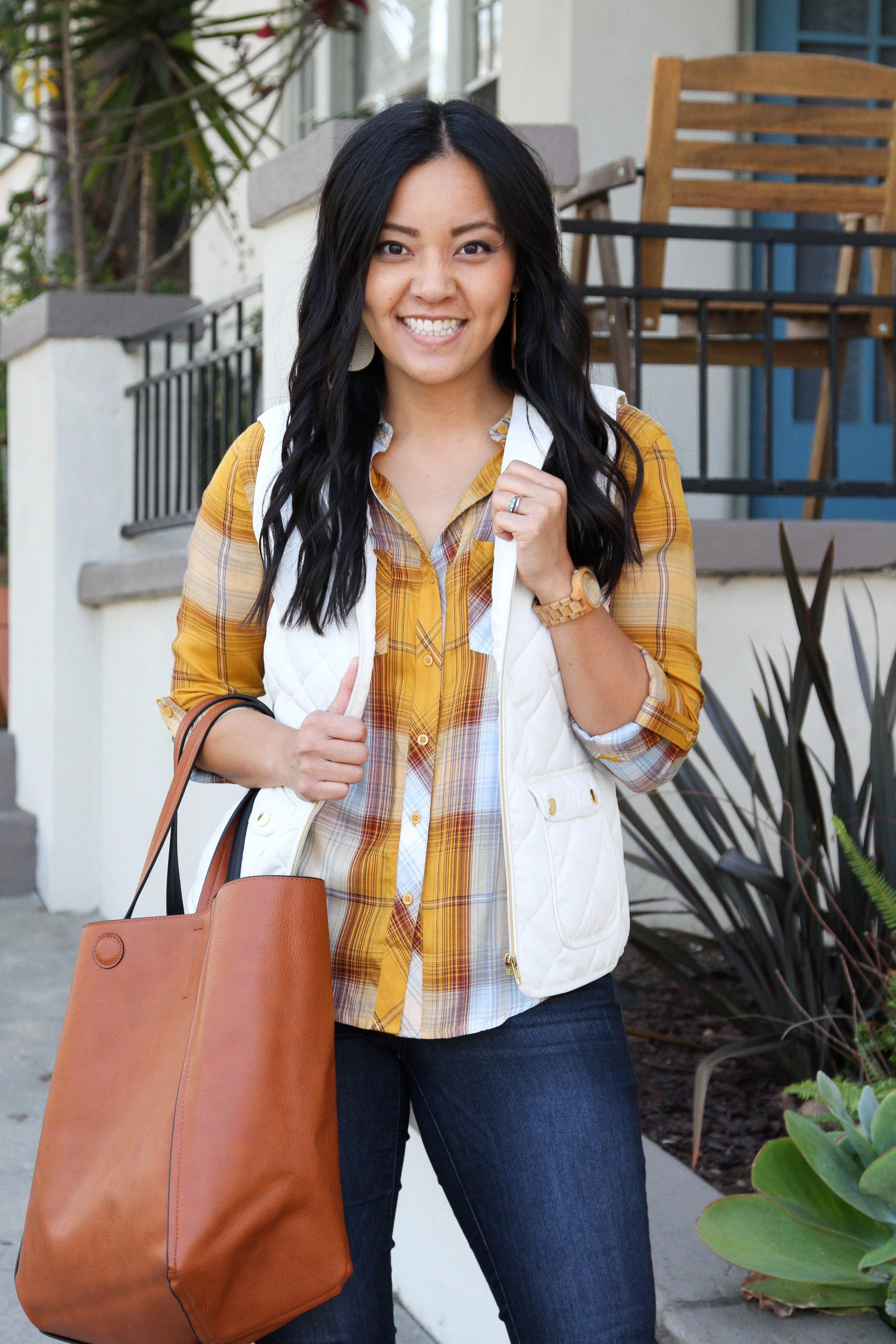 yellow plaid button up + white vest + suede boots + skinny jeans + cognac tote