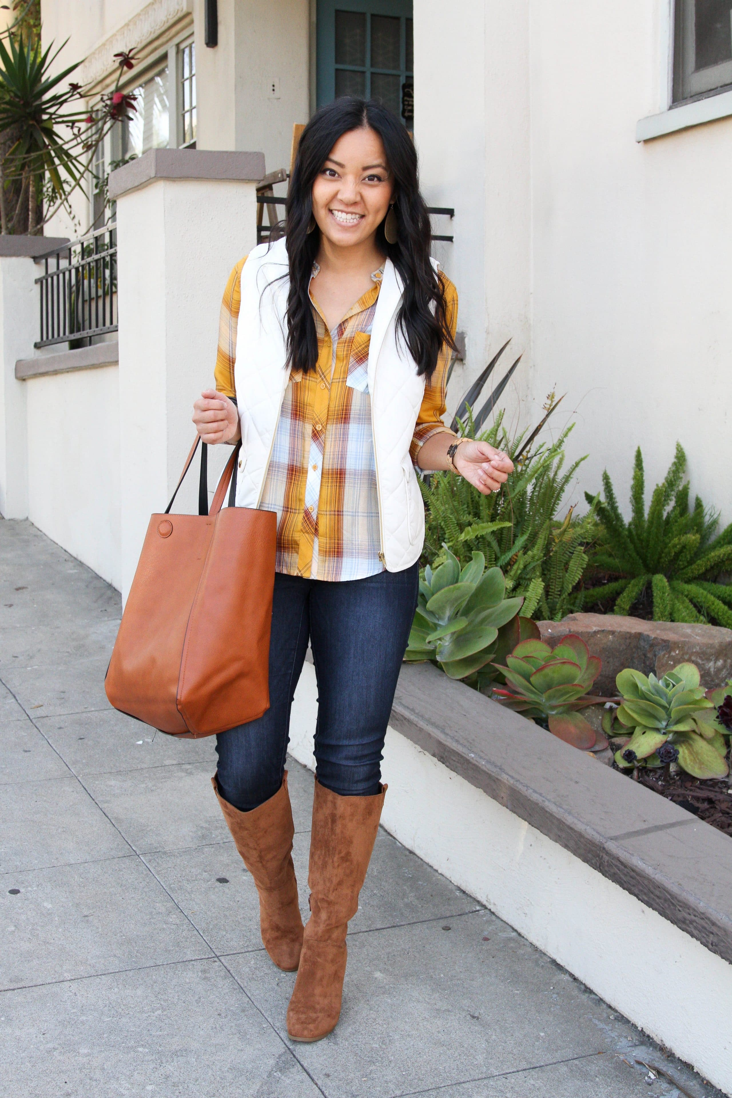 yellow plaid button up + white vest + skinny jeans + suede boots + cognac tote