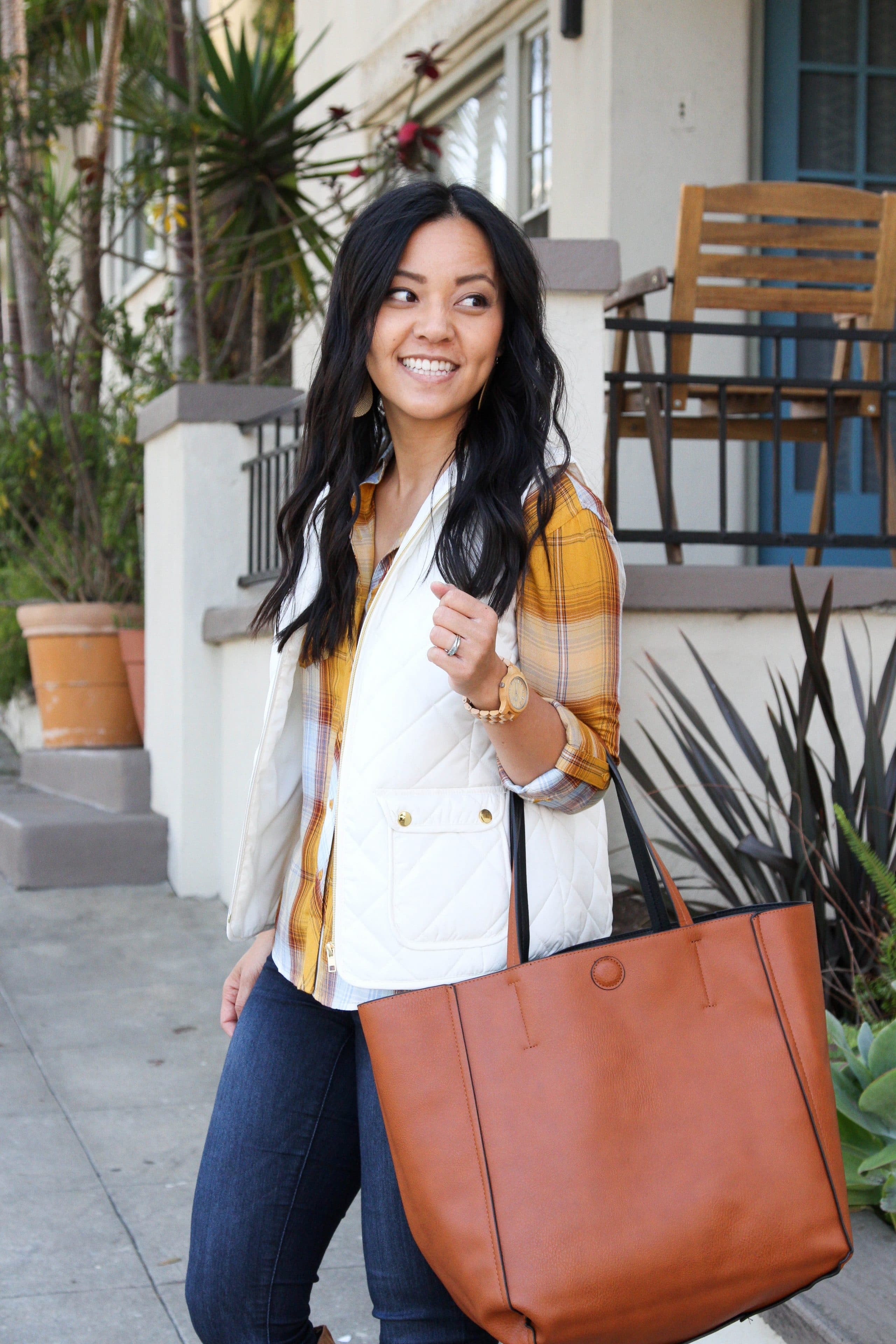 white vest + yellow plaid button up + skinny jeans + suede boots + cognac tote