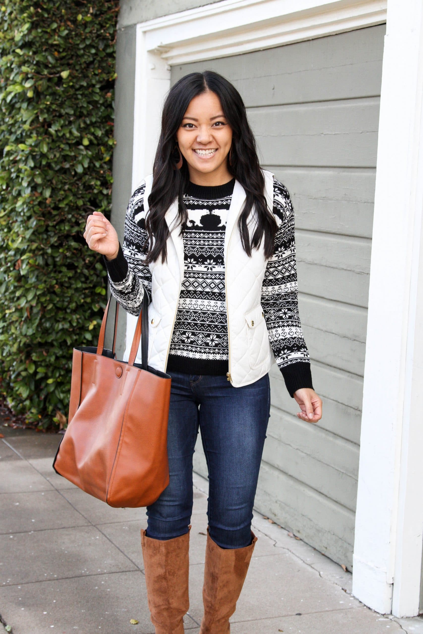 fair isle sweater + skinny jeans + brown boots + white vest