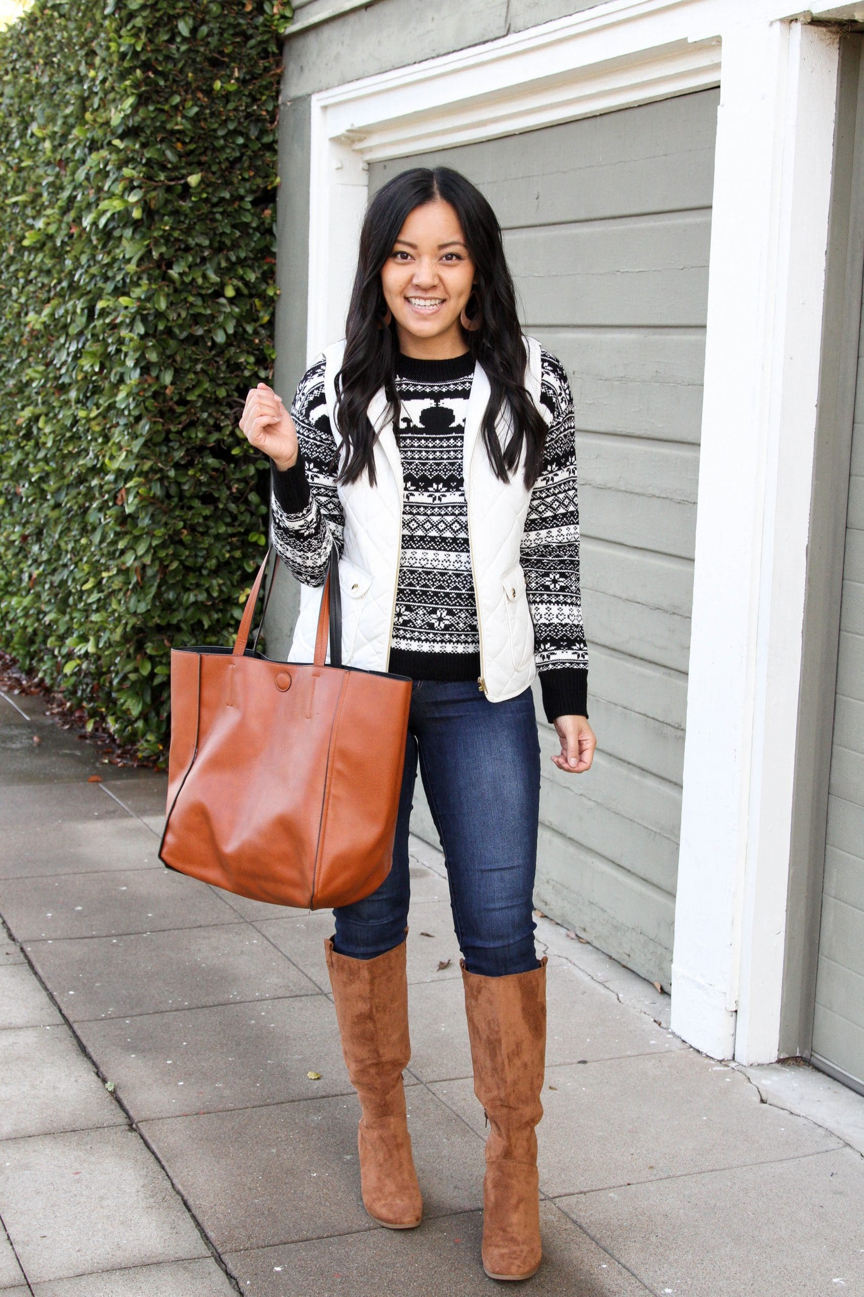 fair isle sweater + skinny jeans + brown boots + white vest + cognac tote