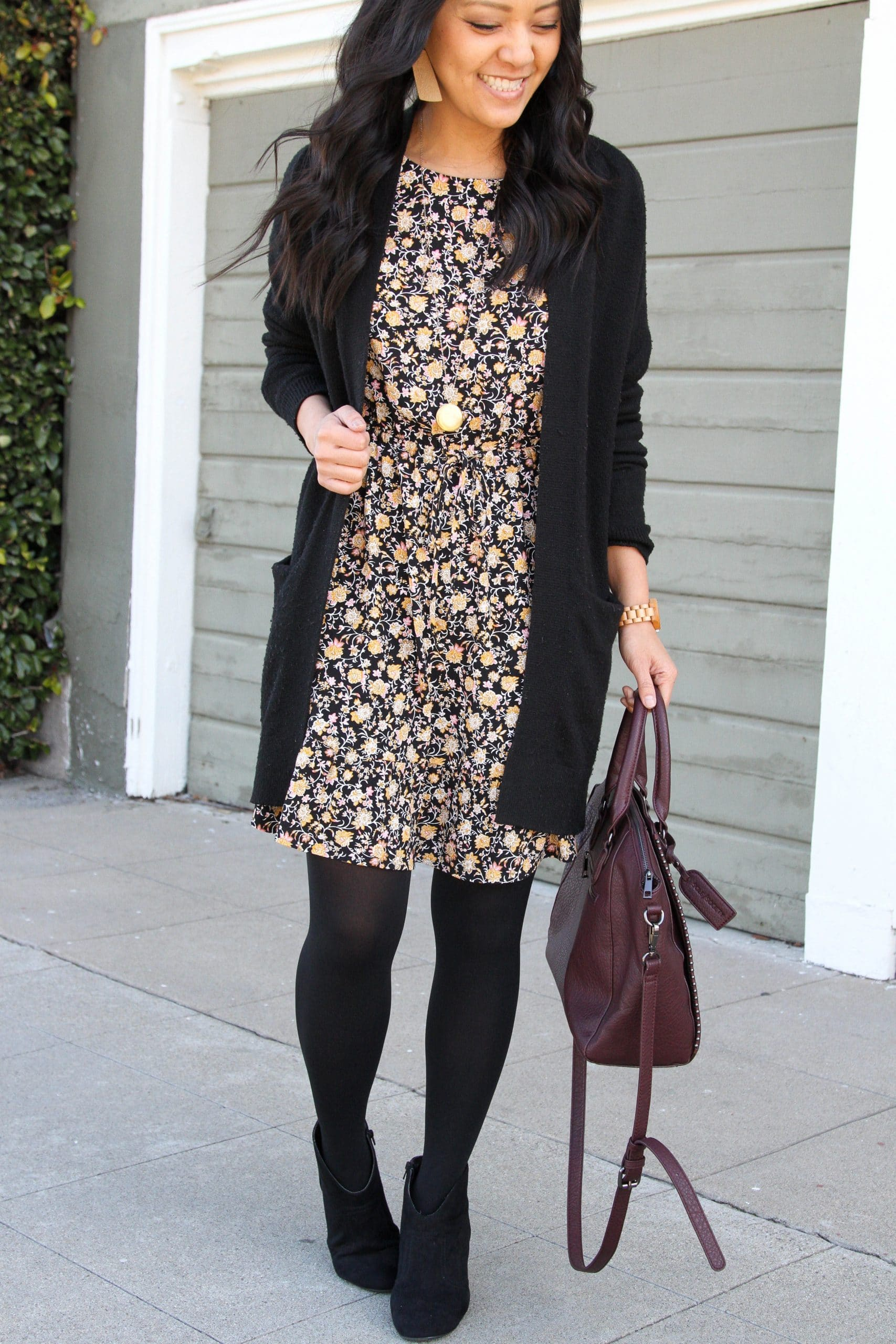 black floral dress + black tights + black long sweater + black booties