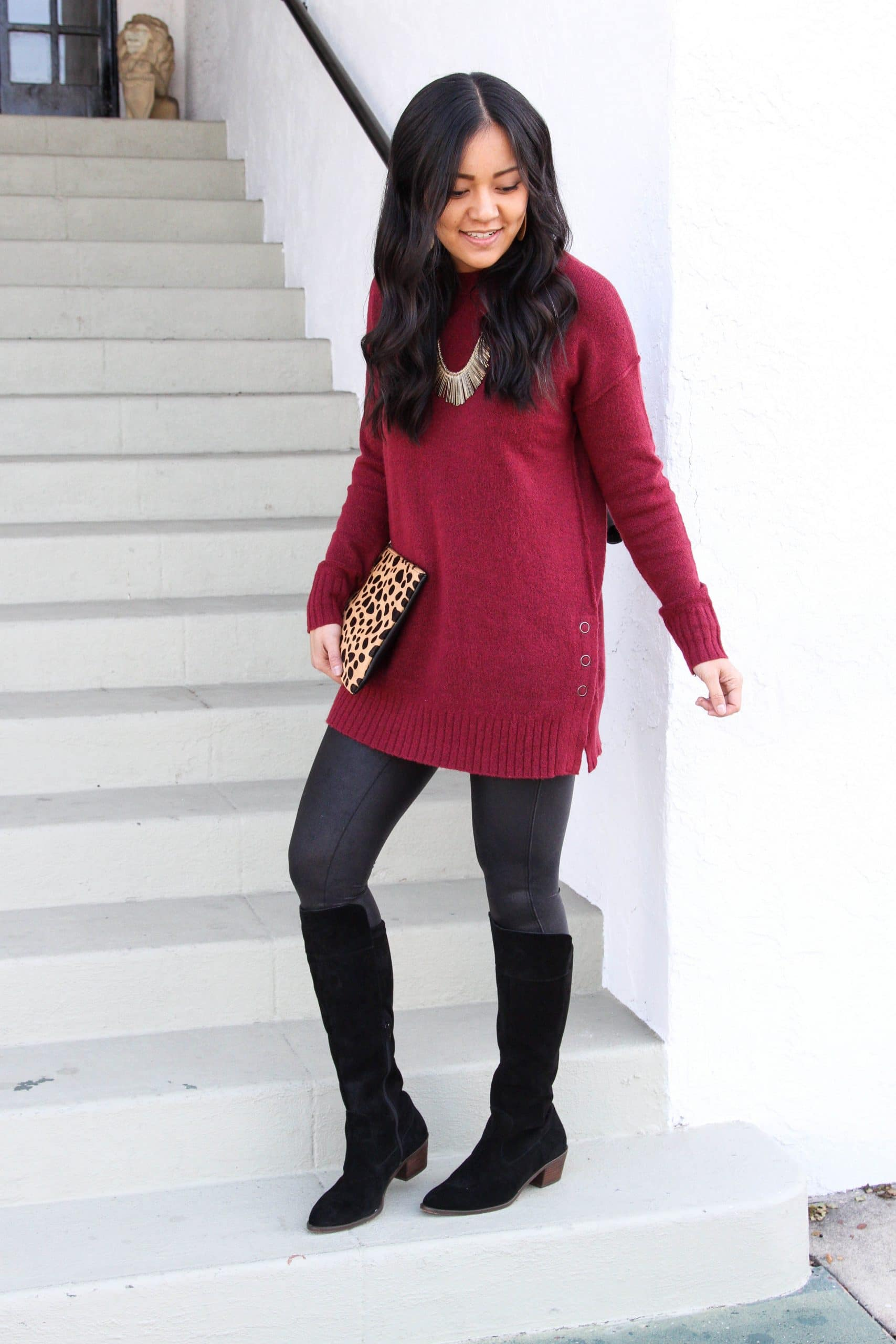 faux leather leggings + maroon sweater + black boots + leopard print clutch