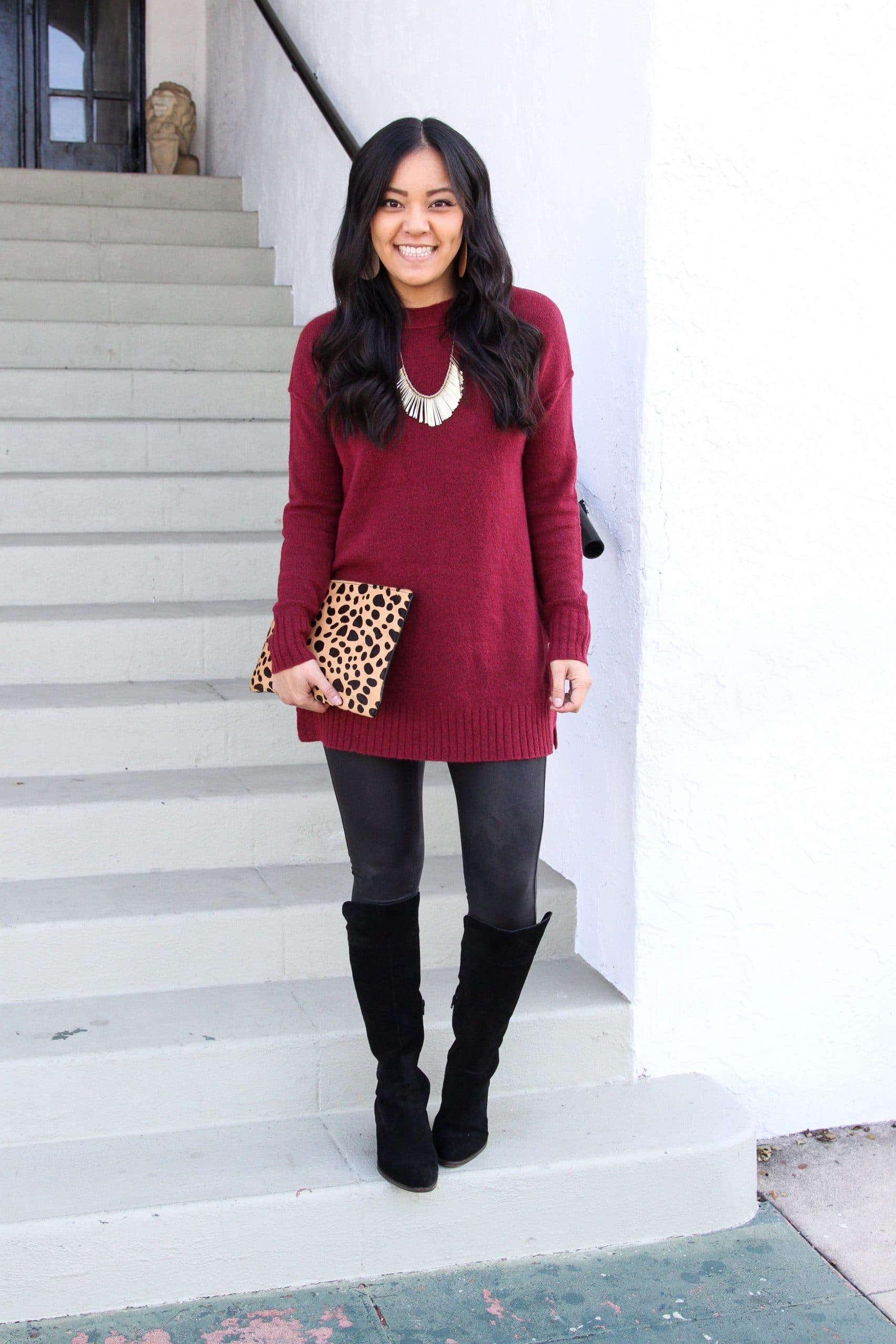 maroon sweater + faux leather leggings + black boots + leopard print clutch