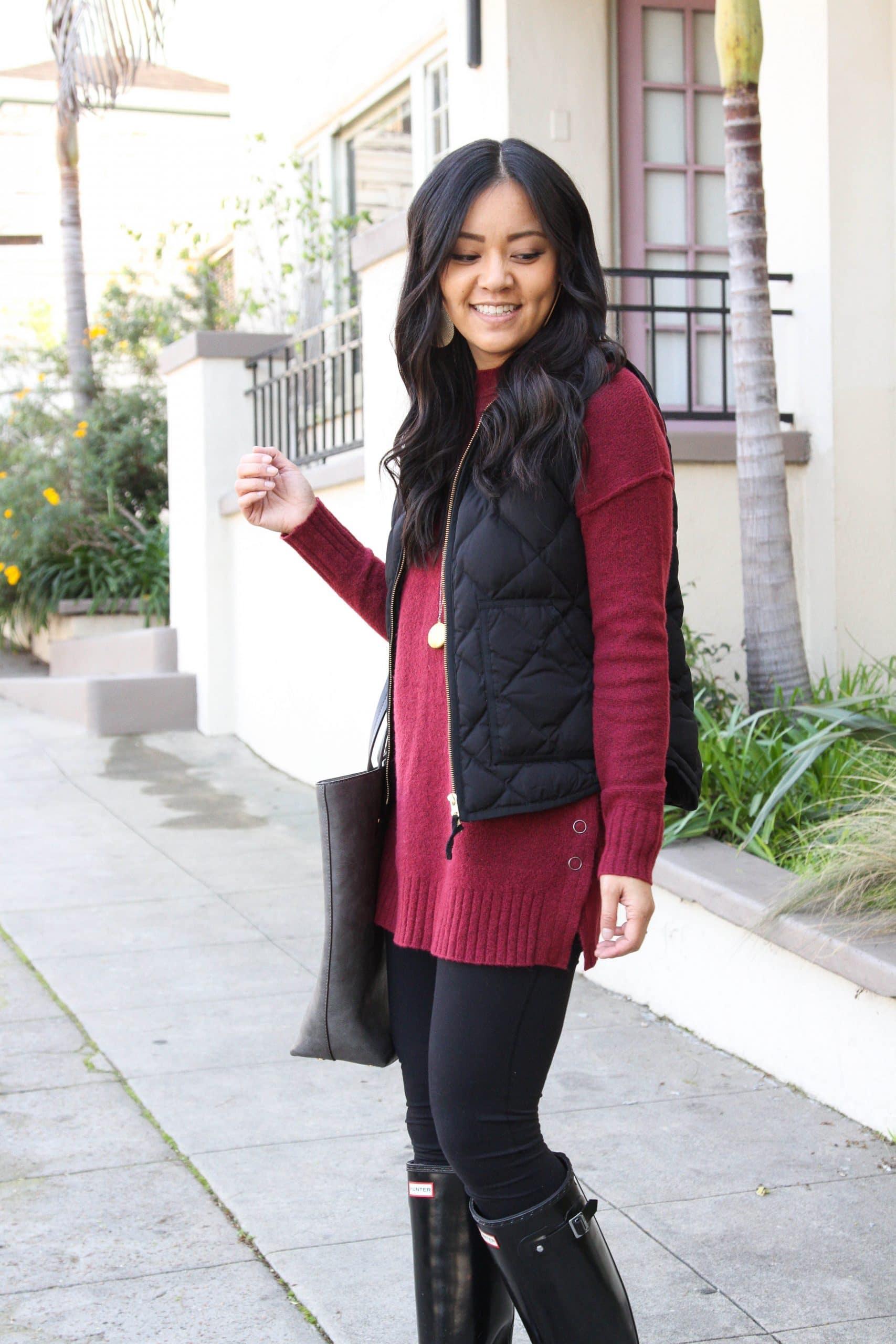 Maroon sweater + black leggings + black vest + black rain boots