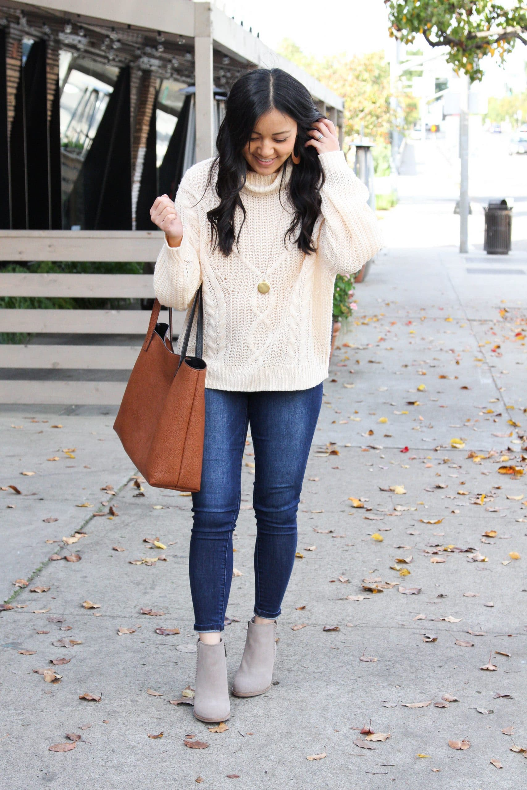 cream cable knit sweater + cognac tote + skinny jeans + taupe booties