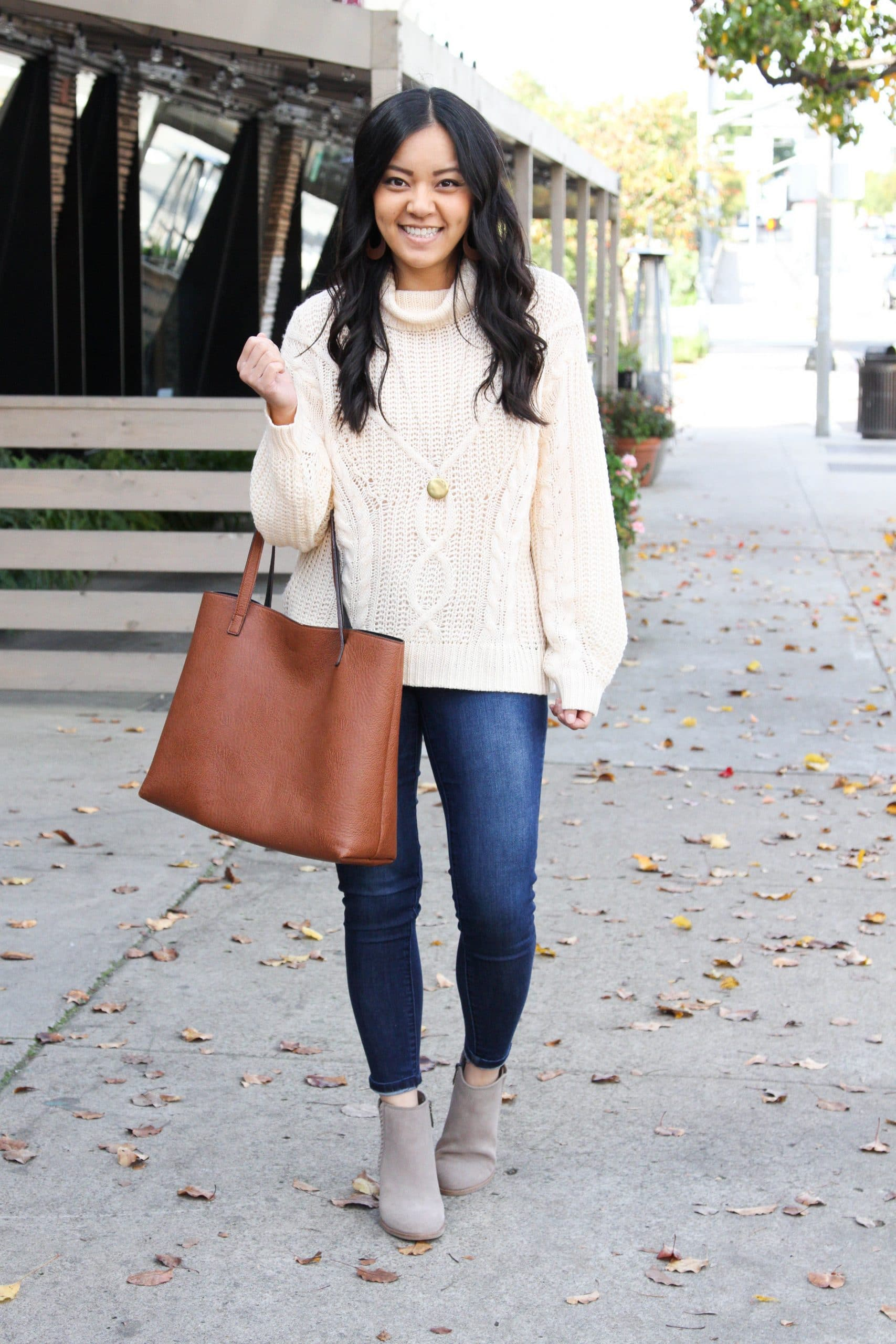 cream cable knit sweater + skinny jeans + cognac tote + taupe booties