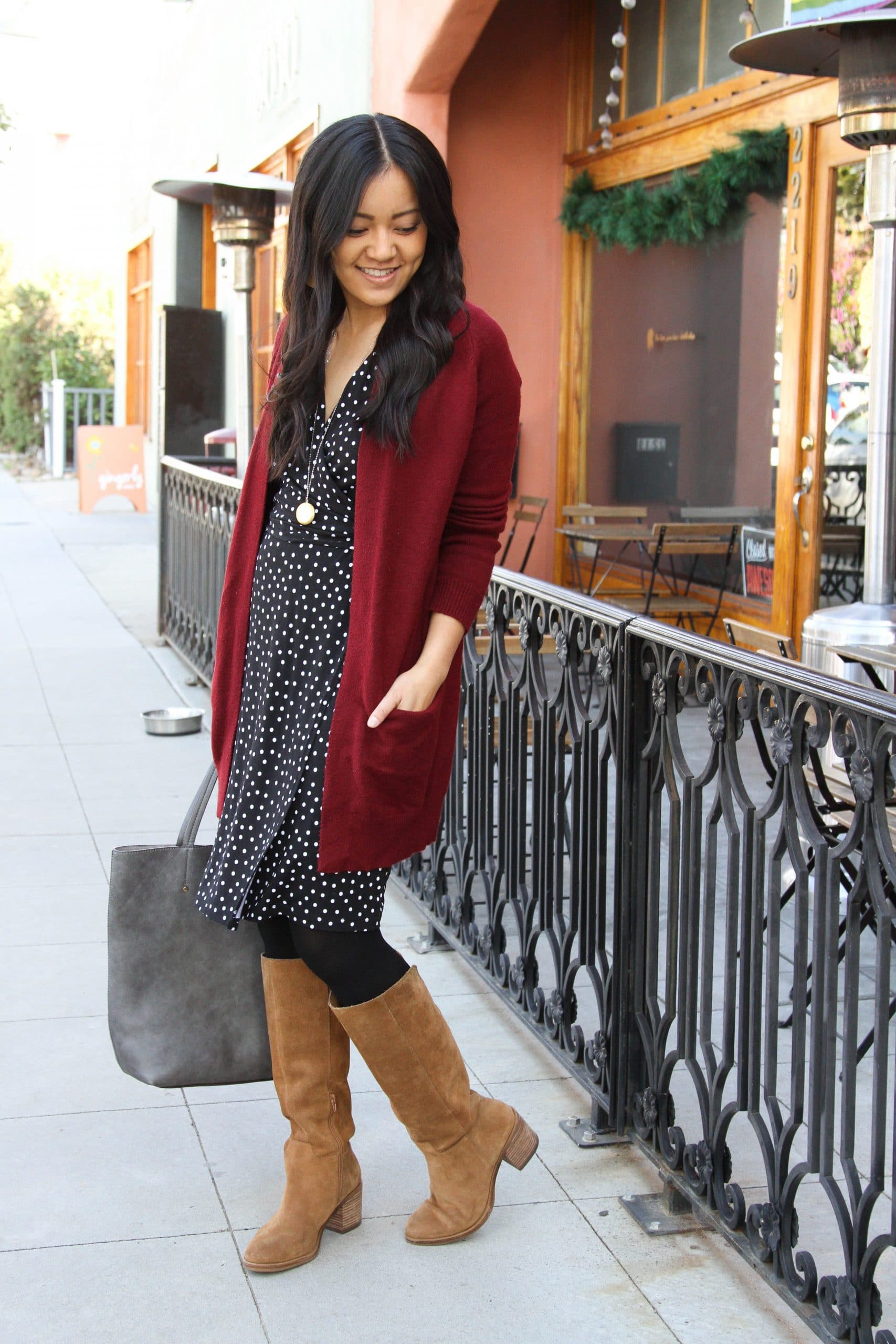 black polka dot dress + maroon long sweater + cognac suede boots + black tights