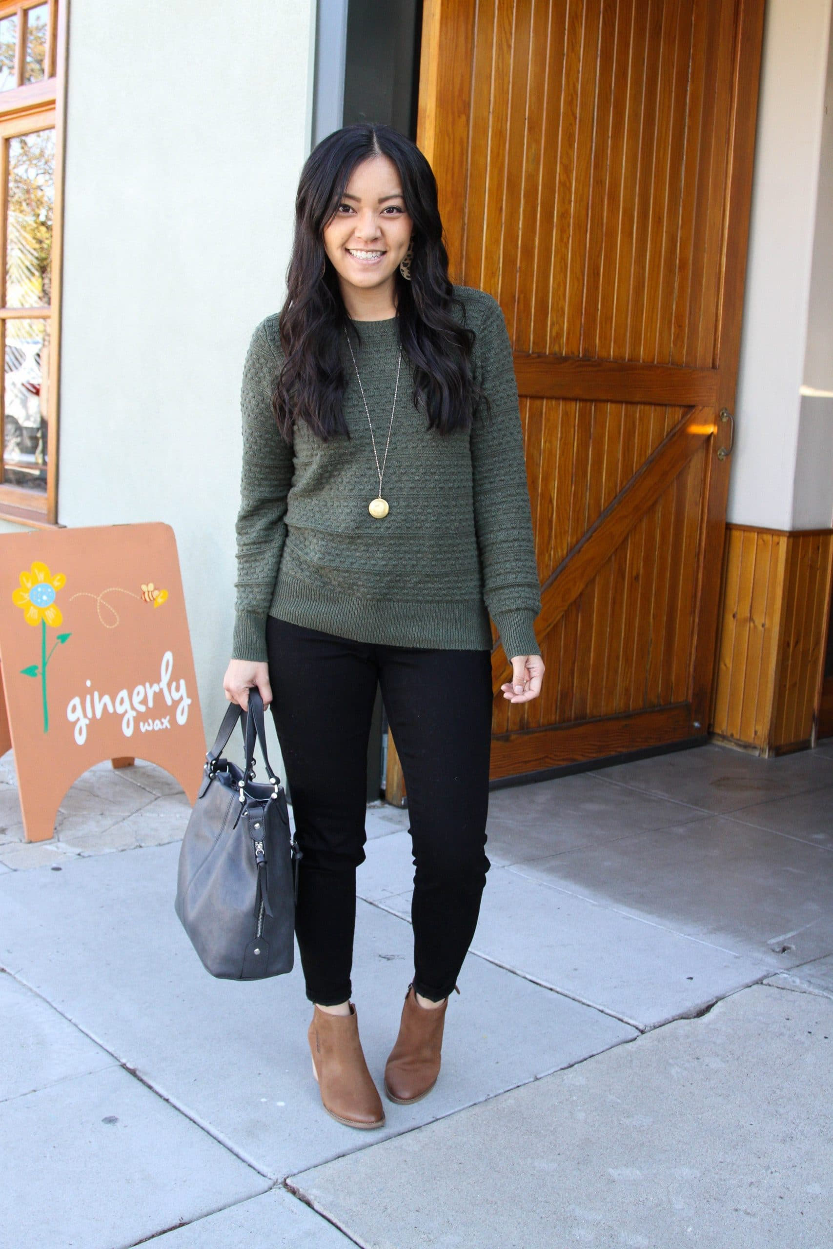 green sweater +black skinny jeans + brown booties + grey purse