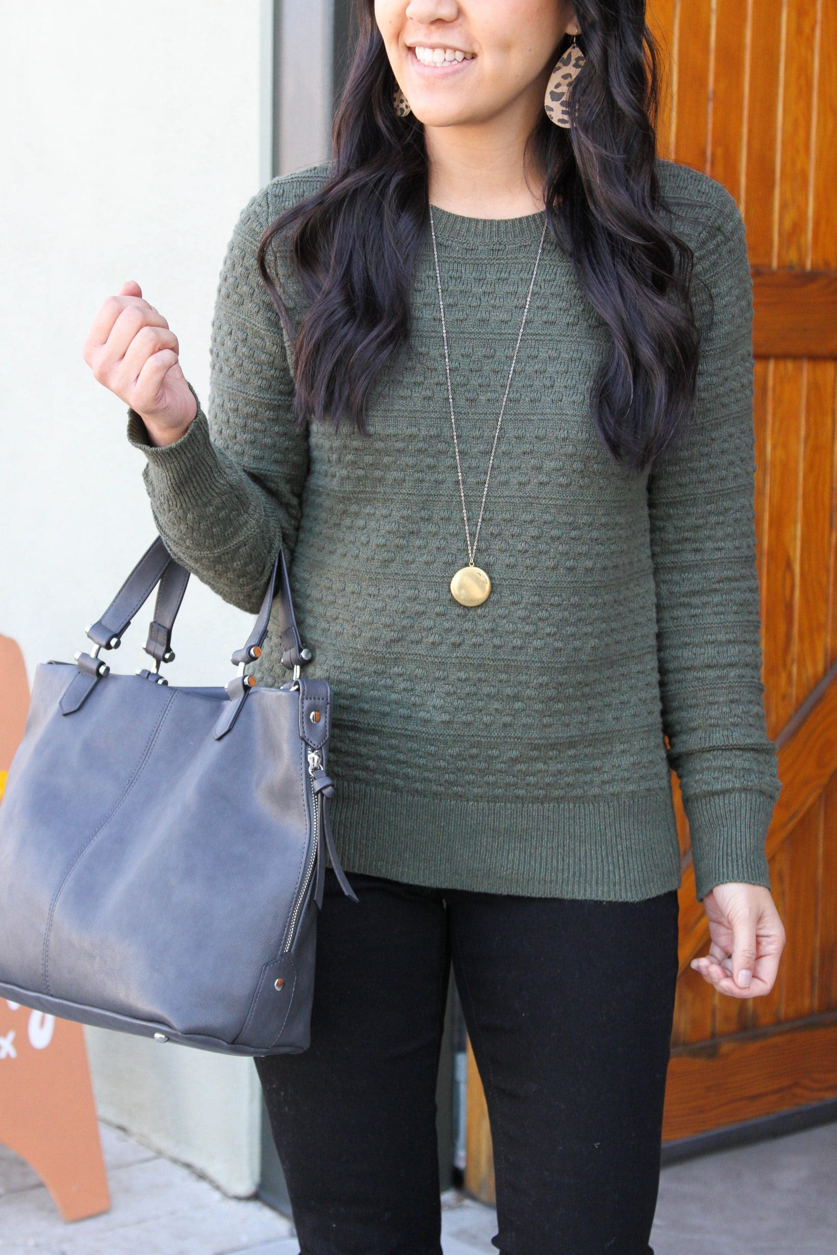 green sweater + black skinny jeans +grey purse + brown booties