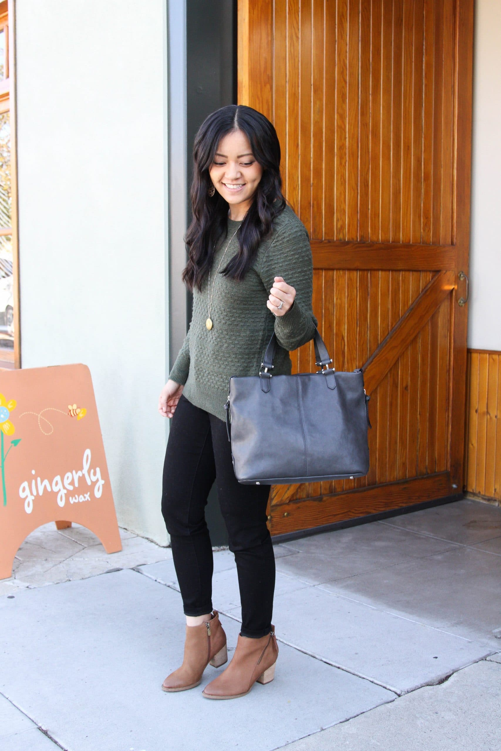 green sweater + grey purse + black skinny jeans + brown booties