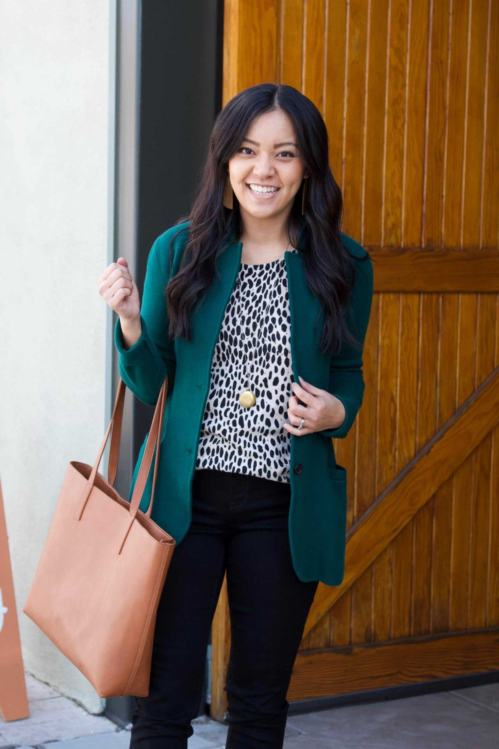 Winter Business Casual Outfit: black skinny jeans + animal print sweater + green sweater blazer + cognac booties + cognac tote + gold pendant necklace