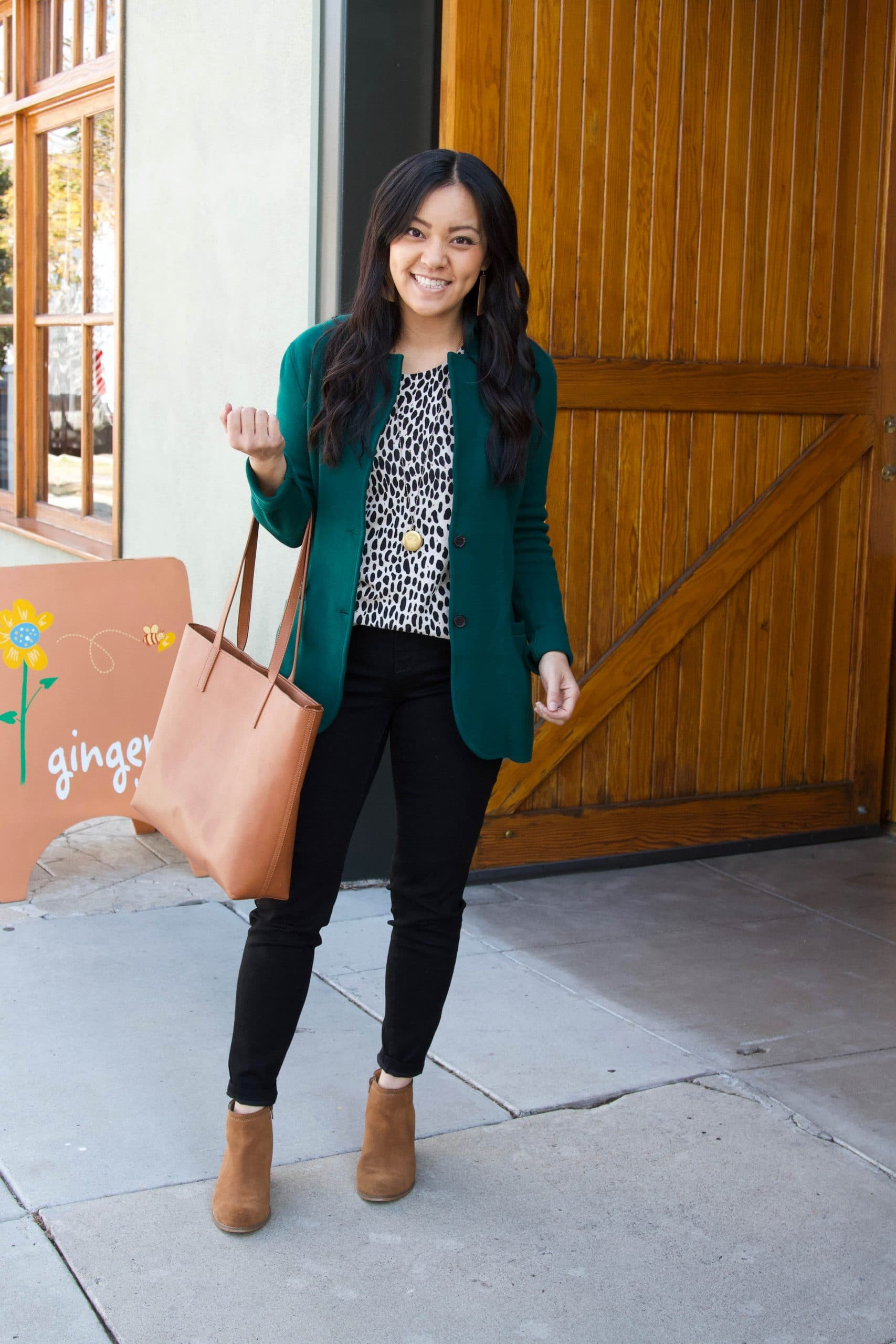 Winter Business Casual Pants Outfit: animal print sweater + green sweater blazer + black jeans + cognac booties + cognac tote + gold pendant necklace