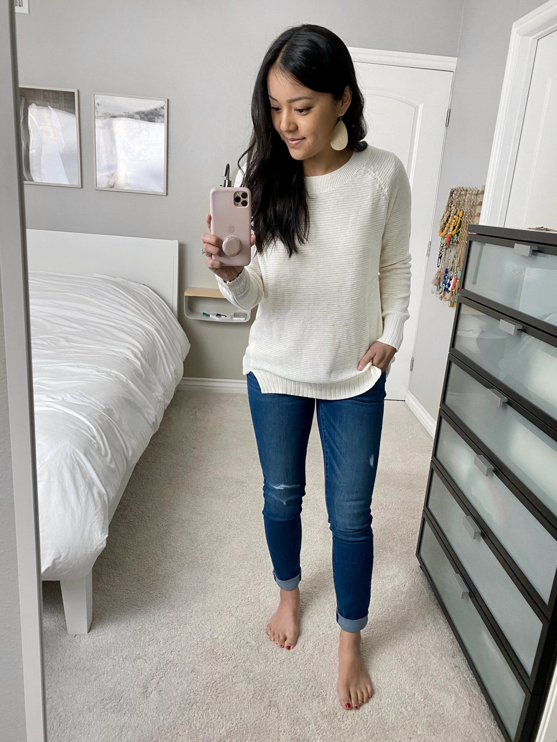 Casual Winter Outfit: cream tunic sweater + maternity skinny jeans + gold leather earrings