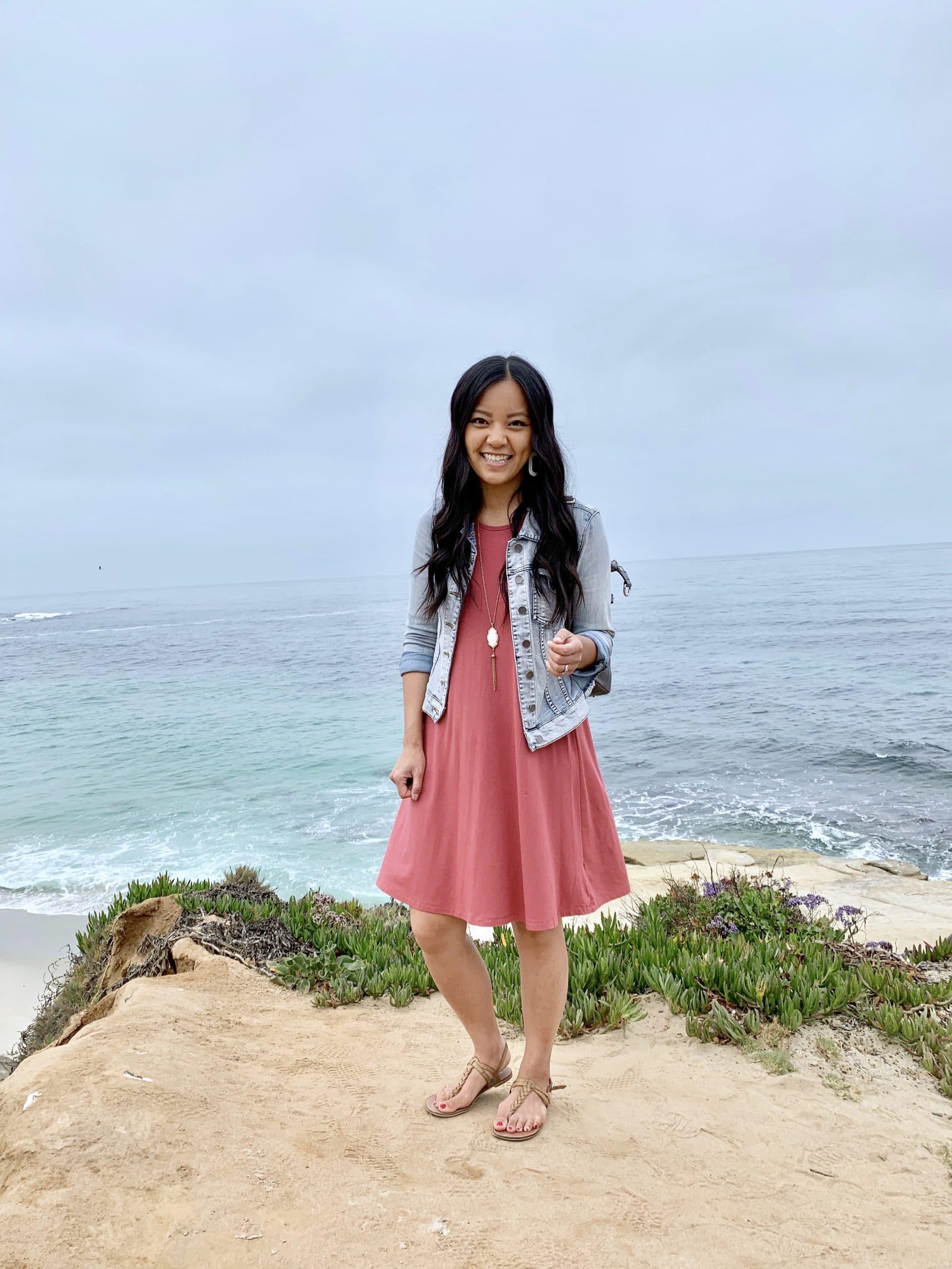 Spring Dress Outfit: pink swing dress + denim jacket + tan sandals + gold tassel necklace