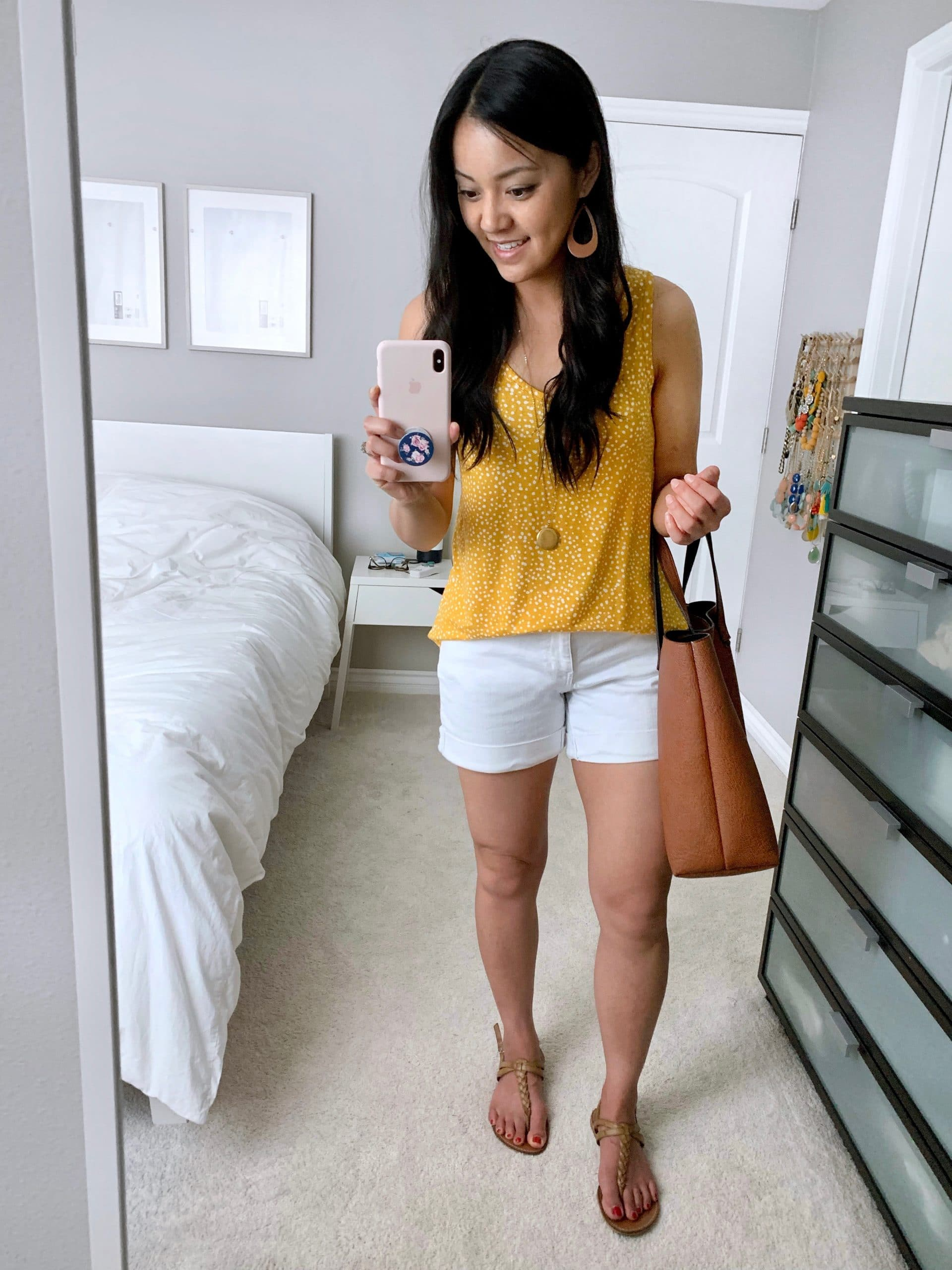 Casual Summer Outfit: yellow printed tank + white shorts + tan thong sandals + cognac tote + long gold disc pendant necklace + tan leather earrings