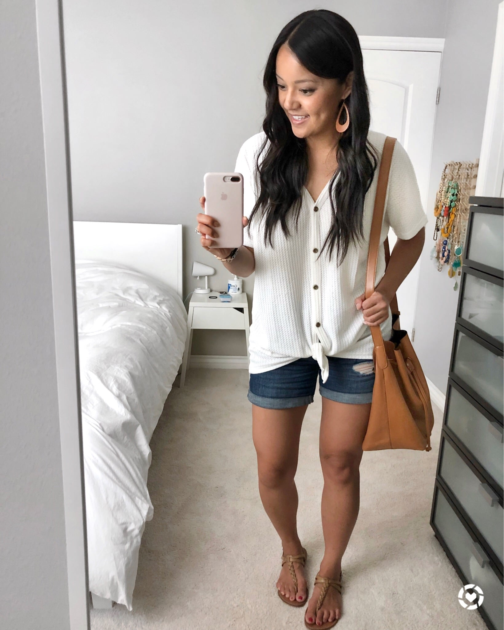 Casual Summer Outfit: white tie-front button-up top + denim cuffed shorts + tan thong sandals + tan crossbody bag + tan leather earrings