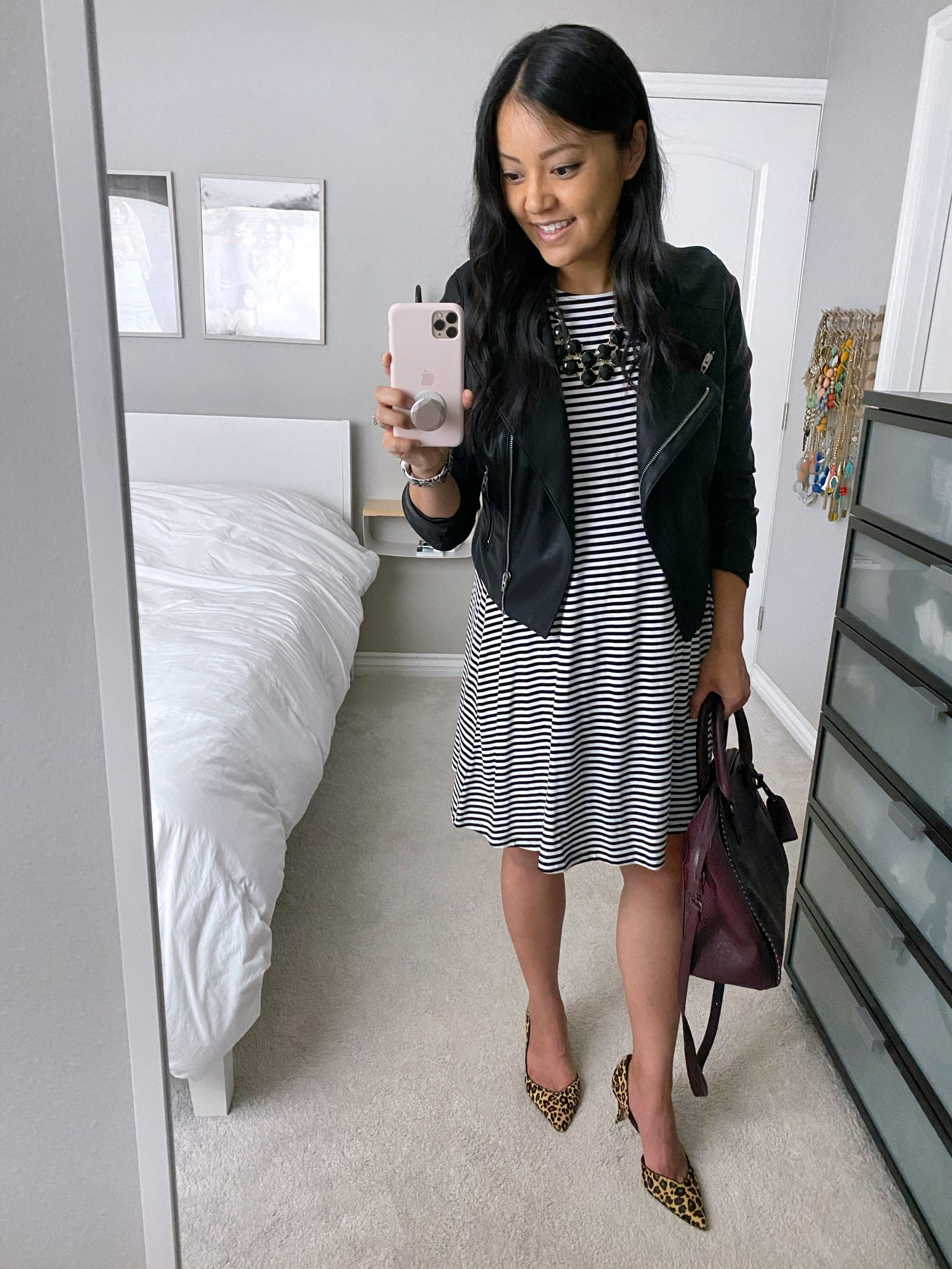 Striped Dress Outfit: black and white striped swing dress + black moto jacket + leopard print heels + maroon bag + black statement necklace