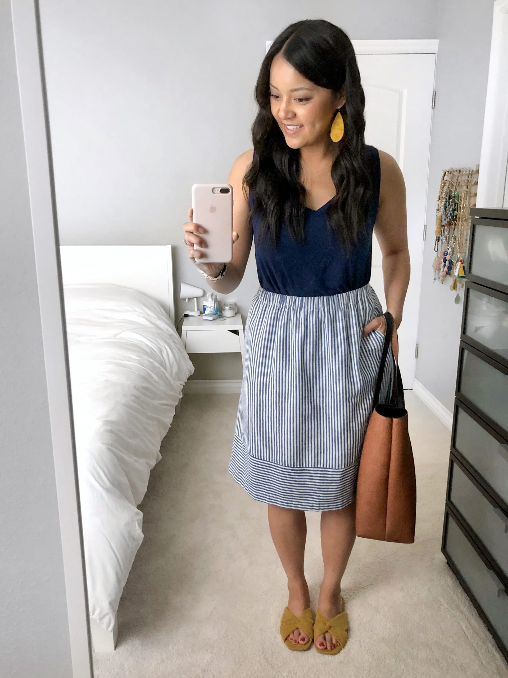Summer Skirt Outfit: navy v-neck tank + navy striped skirt + yellow slide sandals + tan crossbody bag + yellow leather earrings