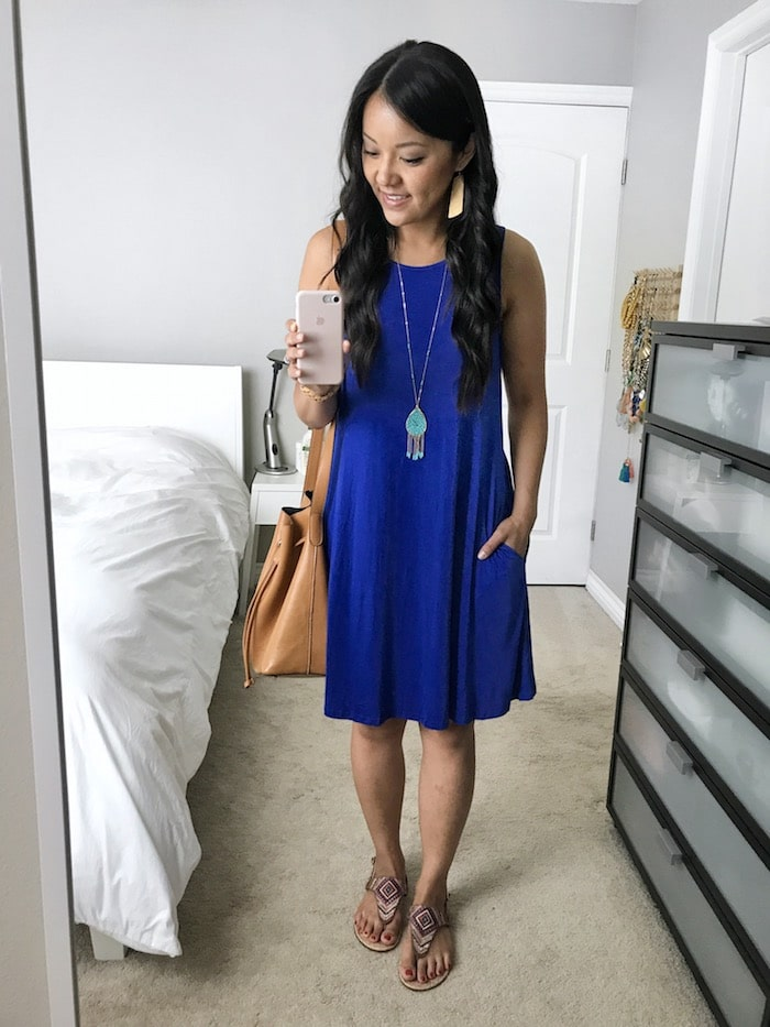 Summer Dress Outfit: royal blue sleeveless swing dress + multicolored sandals + tan drawstring crossbody bag + turquoise pendant necklace + tan leather earrings