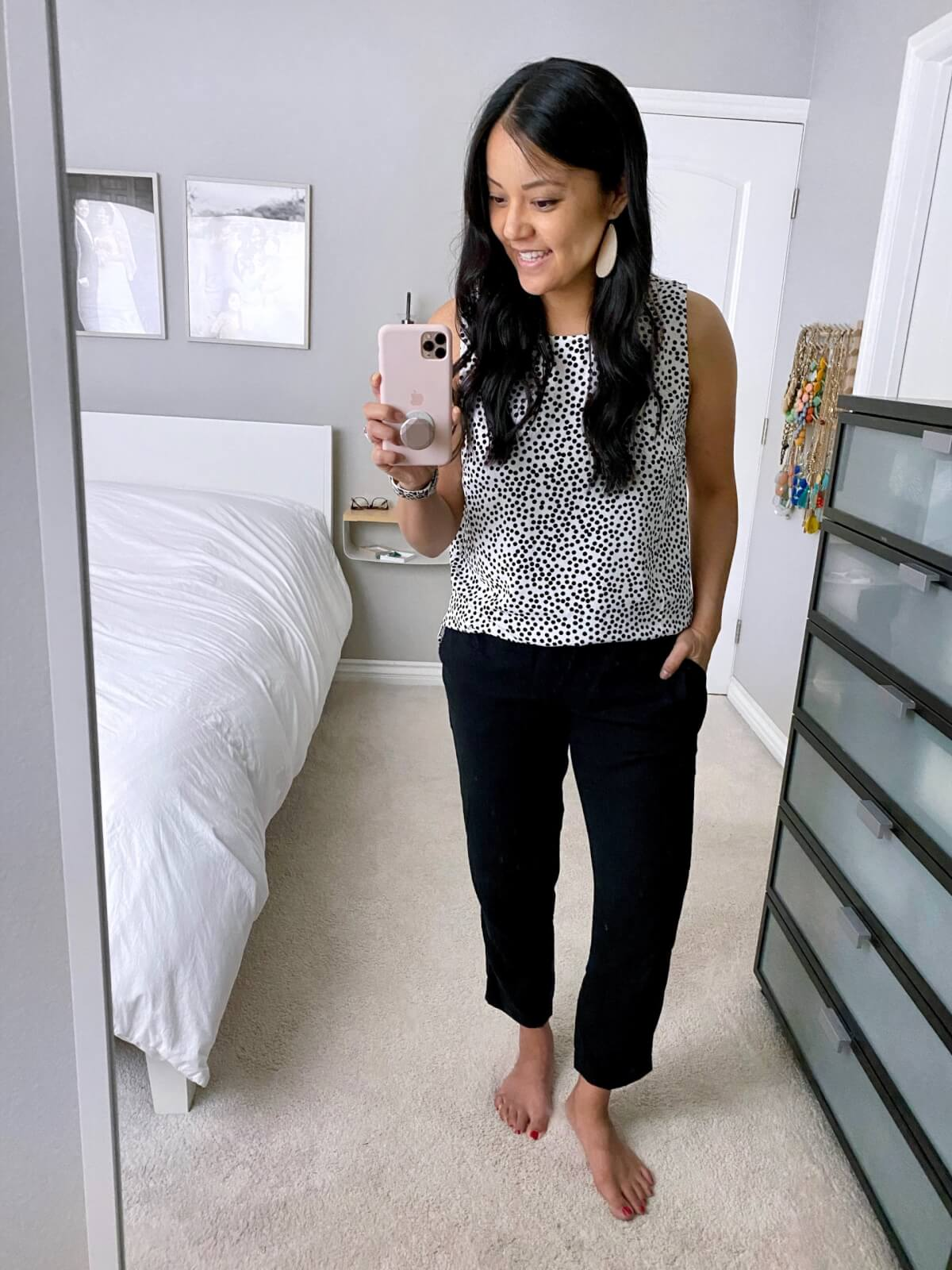 Dressy Casual Outfit: black and white spotted sleeveless top + black linen pants + metallic leather earrings