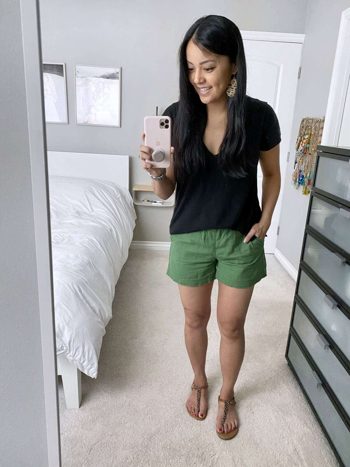 Comfy Casual Outfit: black v-neck tee + olive shorts + leopard print t-strap sandals + leopard print leather earrings